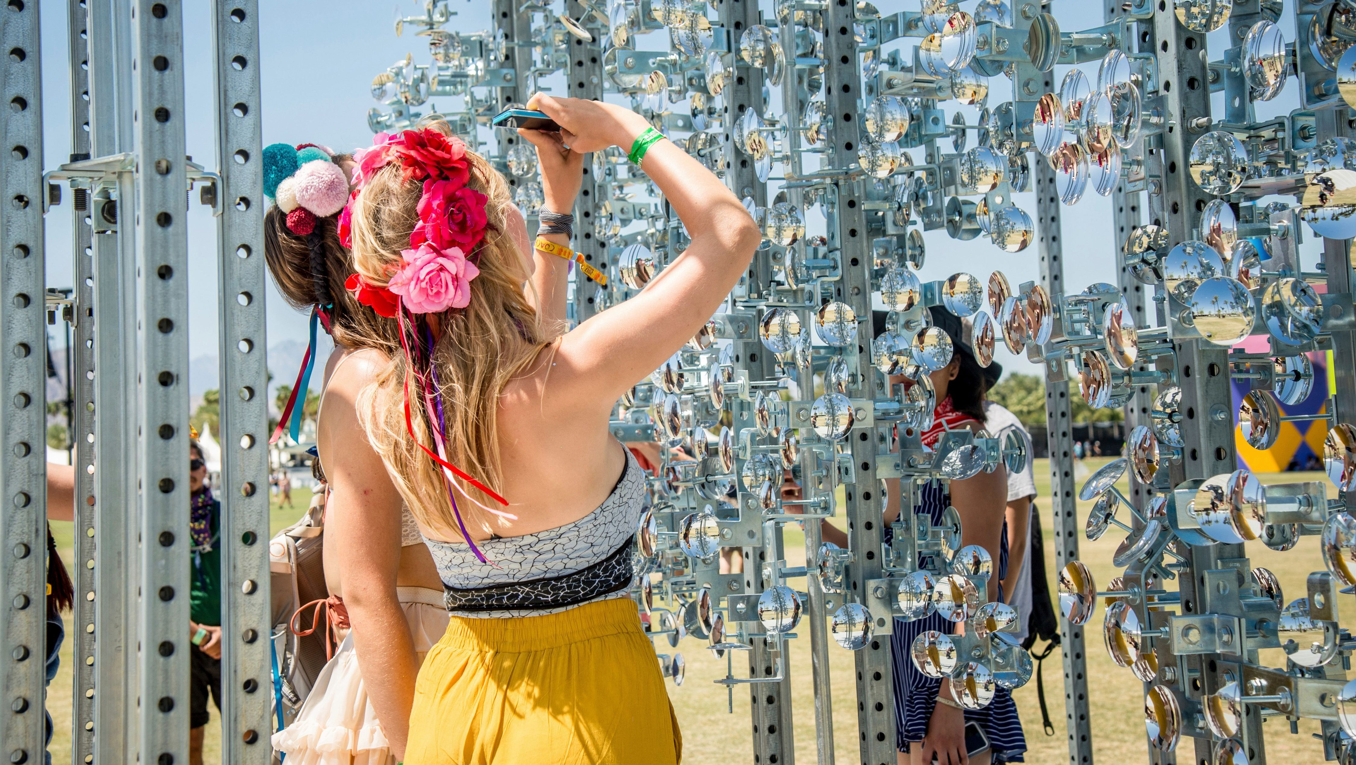 Festival goers Maisie Hoile, left, and Lucie Maguire take a selfie at Coachella Music & Arts Festival at the Empire Polo Club on Saturday, April 15, 2017, in Indio, Calif. (Photo by Amy Harris/Invision/AP)