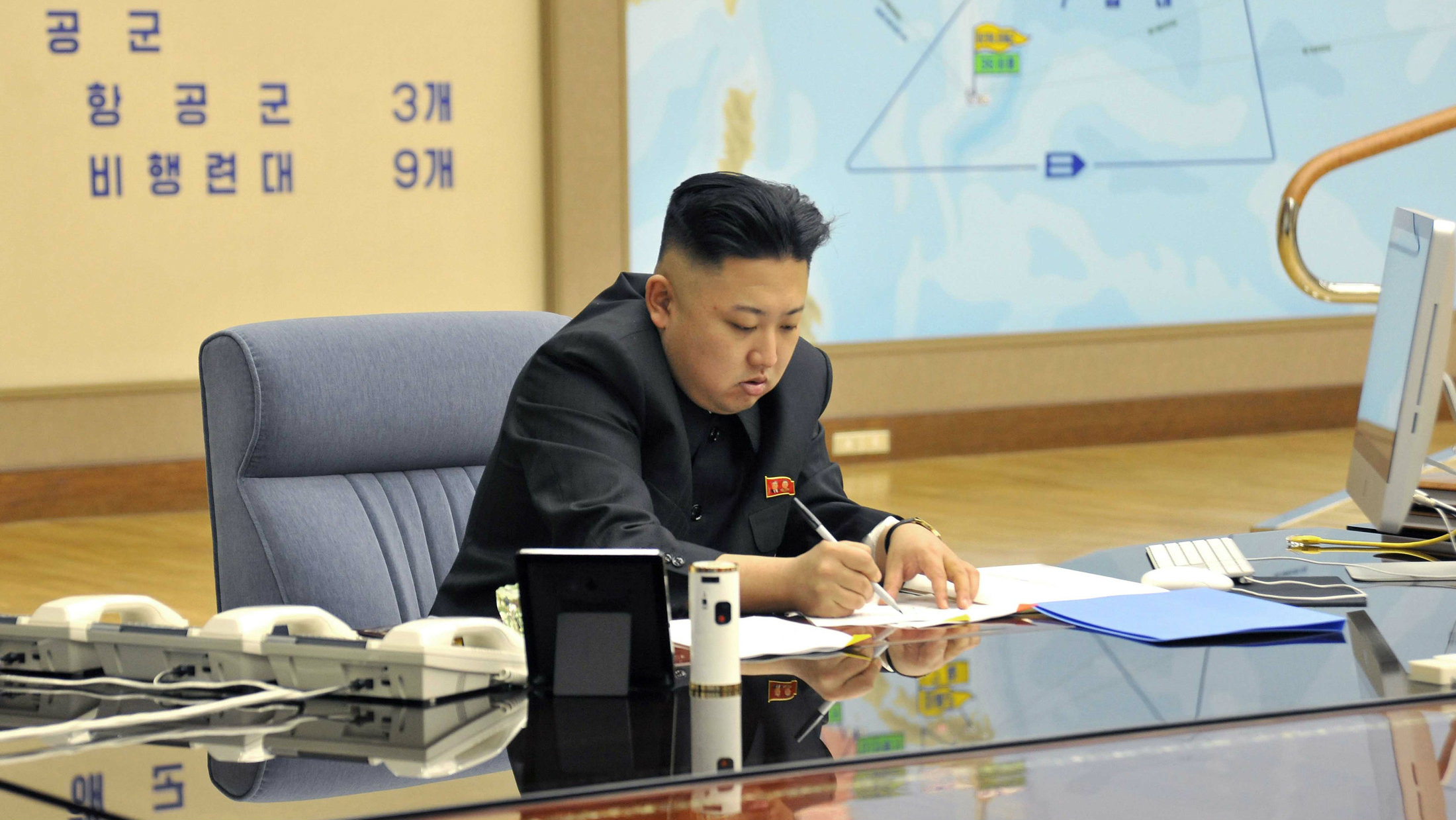 North Korean leader Kim Jong-un presides over an urgent operation meeting on the Korean People's Army Strategic Rocket Force's performance of duty for firepower strike at the Supreme Command in Pyongyang, early March 29, 2013, in this picture released by the North's official KCNA news agency on Friday.
