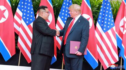 U.S. President Donald Trump shakes hands with North Korean leader Kim Jong Un at the Capella Hotel on Sentosa island in Singapore in this picture released on June 12, 2018 by North Korea's Korean Central News Agency.