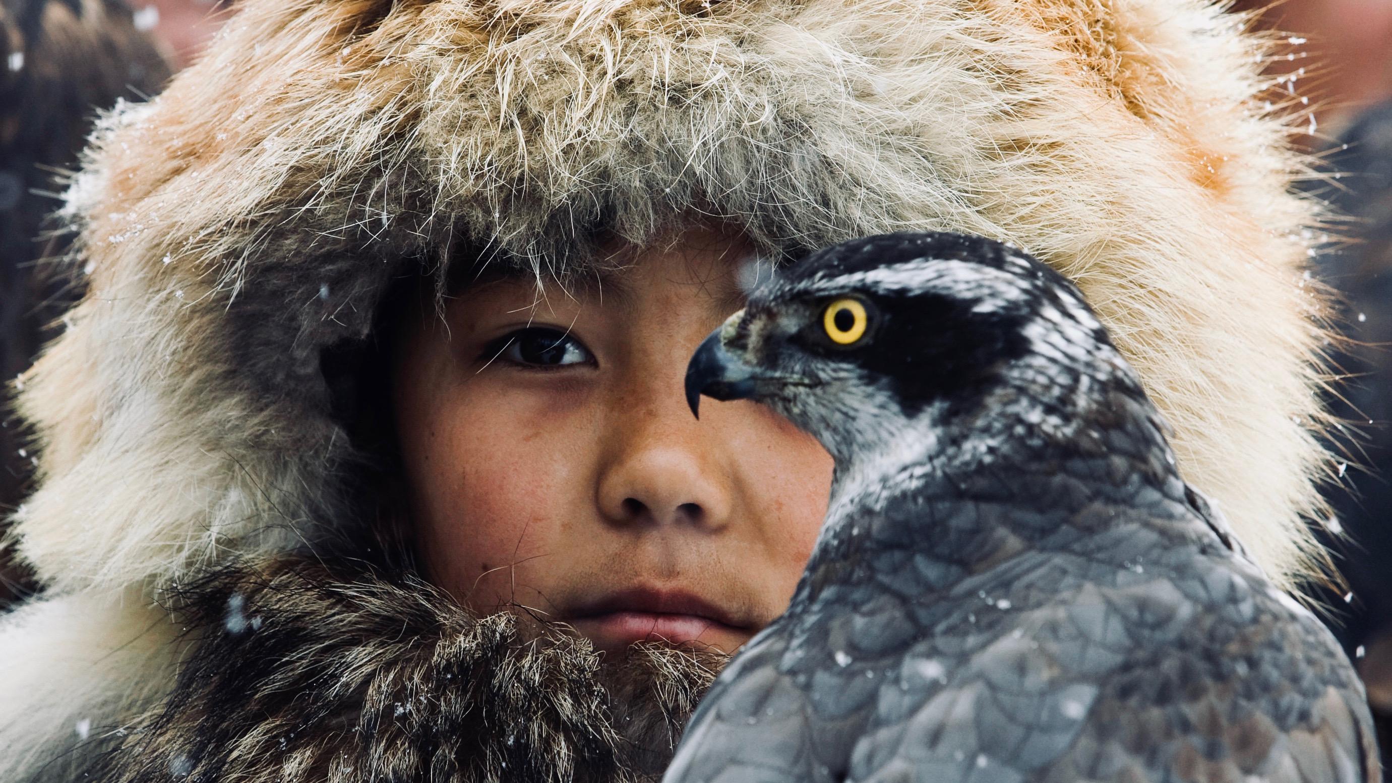 Child and hawk.