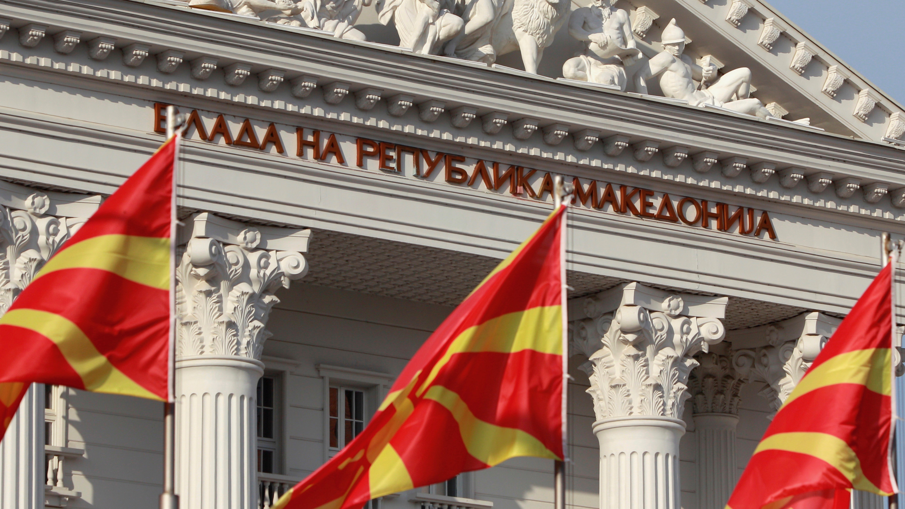 National Macedonian flags flutter in front of the government building in Skopje, Macedonia.