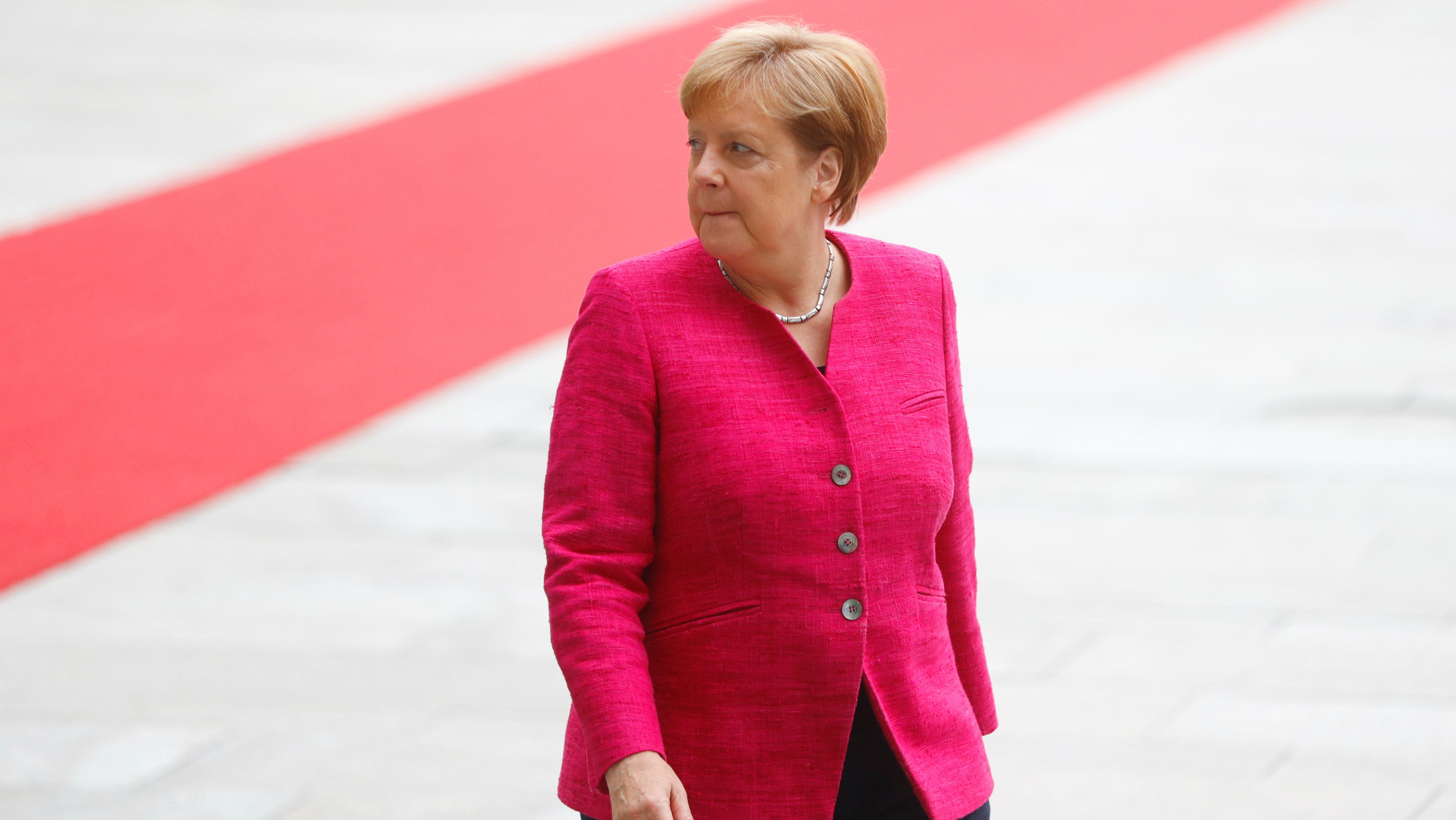 German chancellor Angela Merkel looks on as she welcomes Spanish Prime Minister Pedro Sanchez