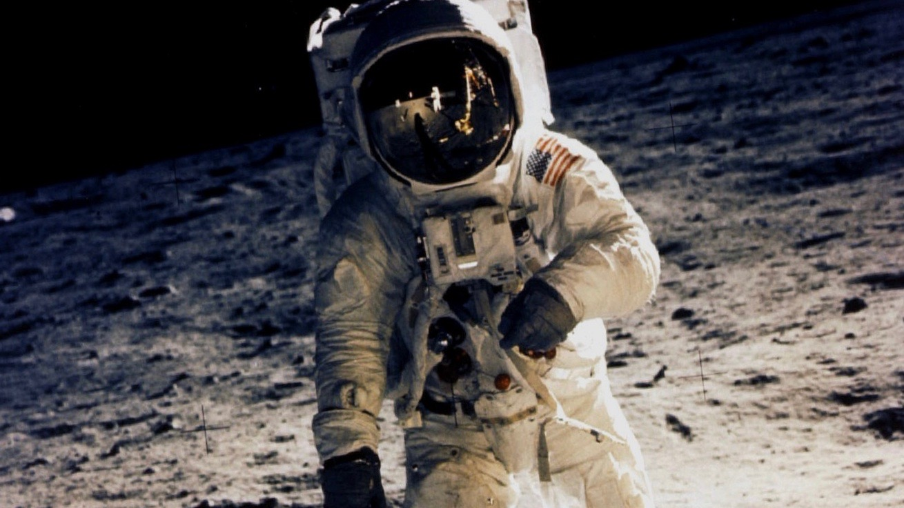 """Astronaut Edwin """"Buzz"""" Aldrin walks on the moon July 20, 1969, photographed by Neil Armstrong."""
