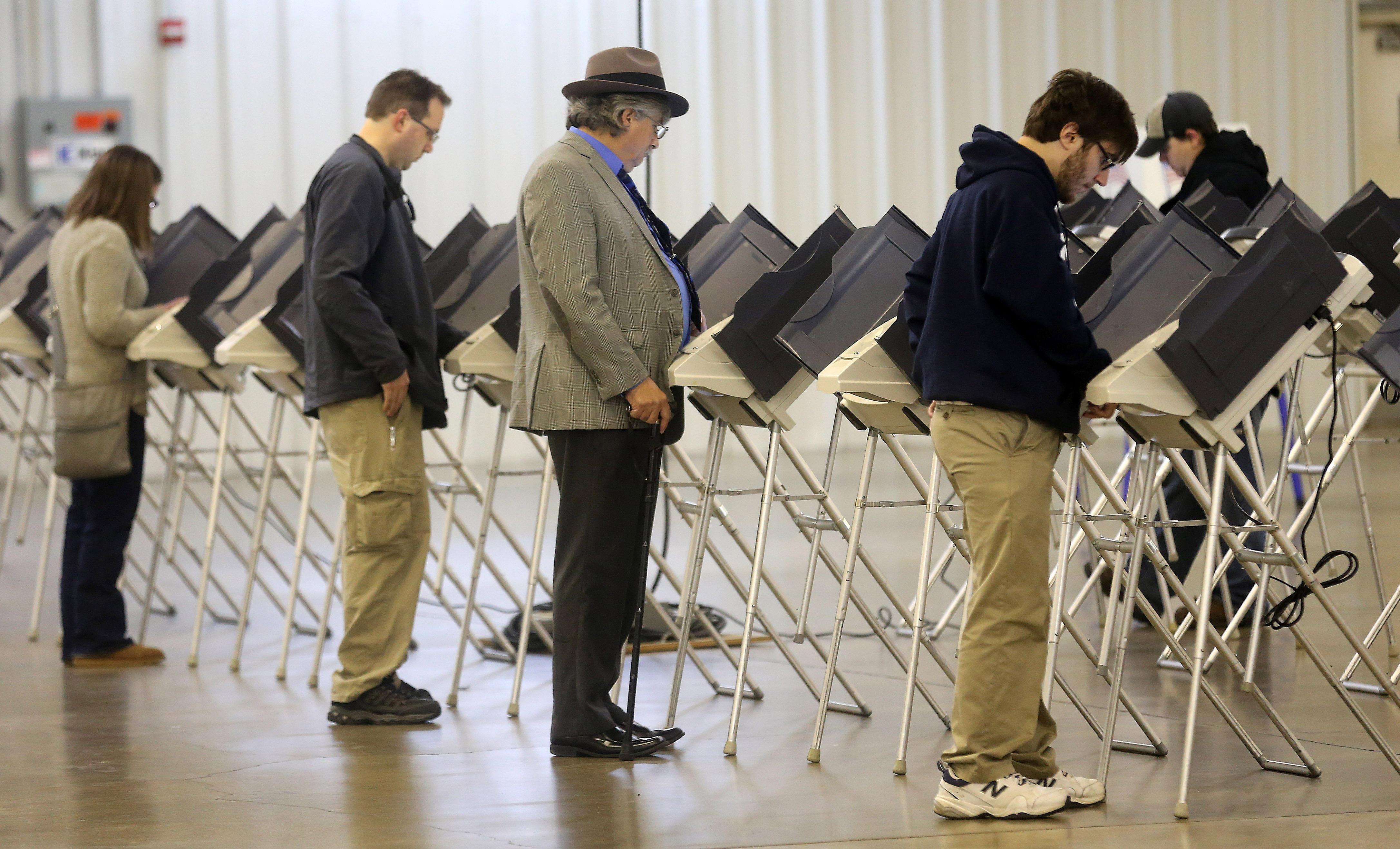 Voters cast their votes during the U.S. presidential election in Medina, Ohio, U.S. November 8, 2016.