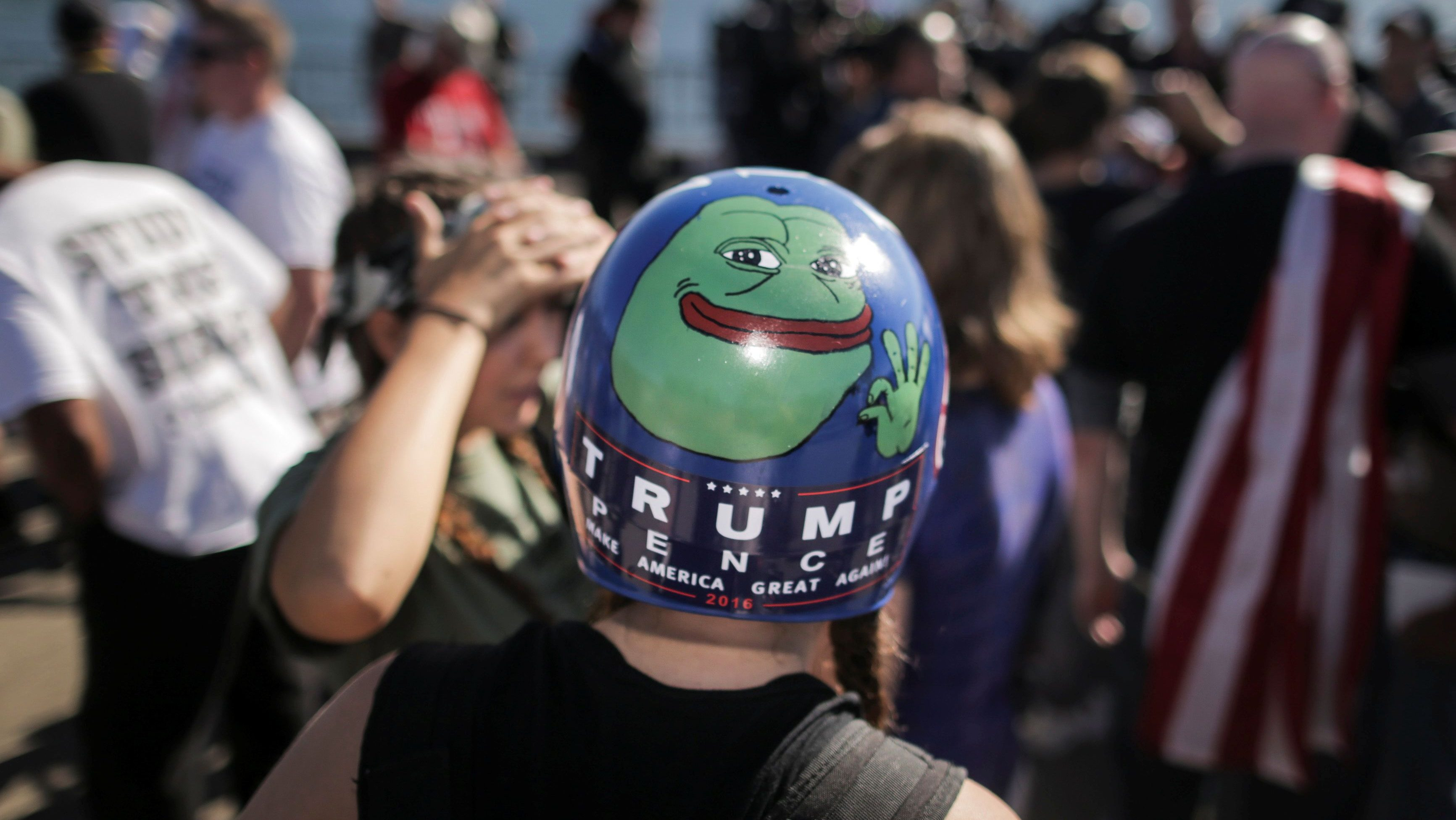 Jaeda Ferrel, of Seattle, wears a helmet adorned with an image of Pepe the frog that she hand-painted and a Trump/Pence sticker at a rally organized by the right-wing group Patriot Prayer in Vancouver, Washington, U.S. September 10, 2017.