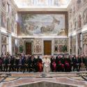 Pope Francis poses with oil and energy leaders during a private meeting at the Vatican, June 9, 2018.