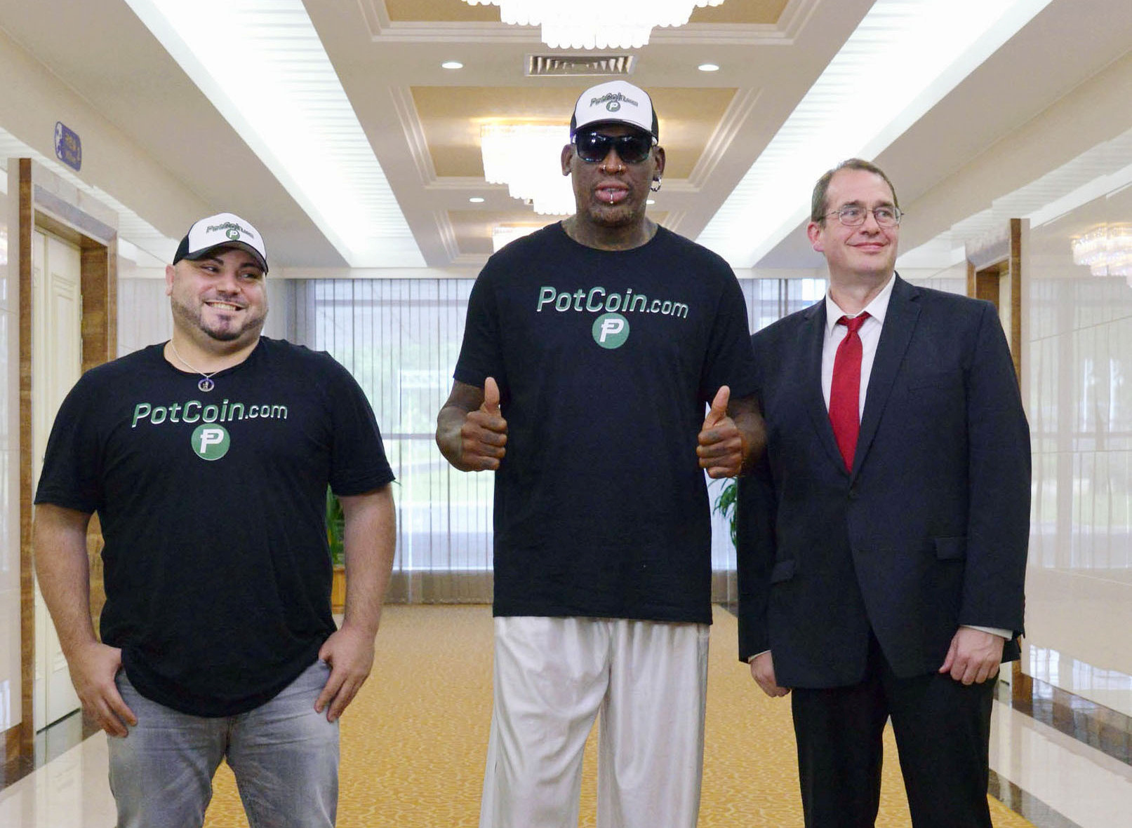 Former U.S. basketball star Dennis Rodman (C) arrives at Pyongyang's international airport, North Korea in this photo taken by Kyodo on June on June 13, 2017.