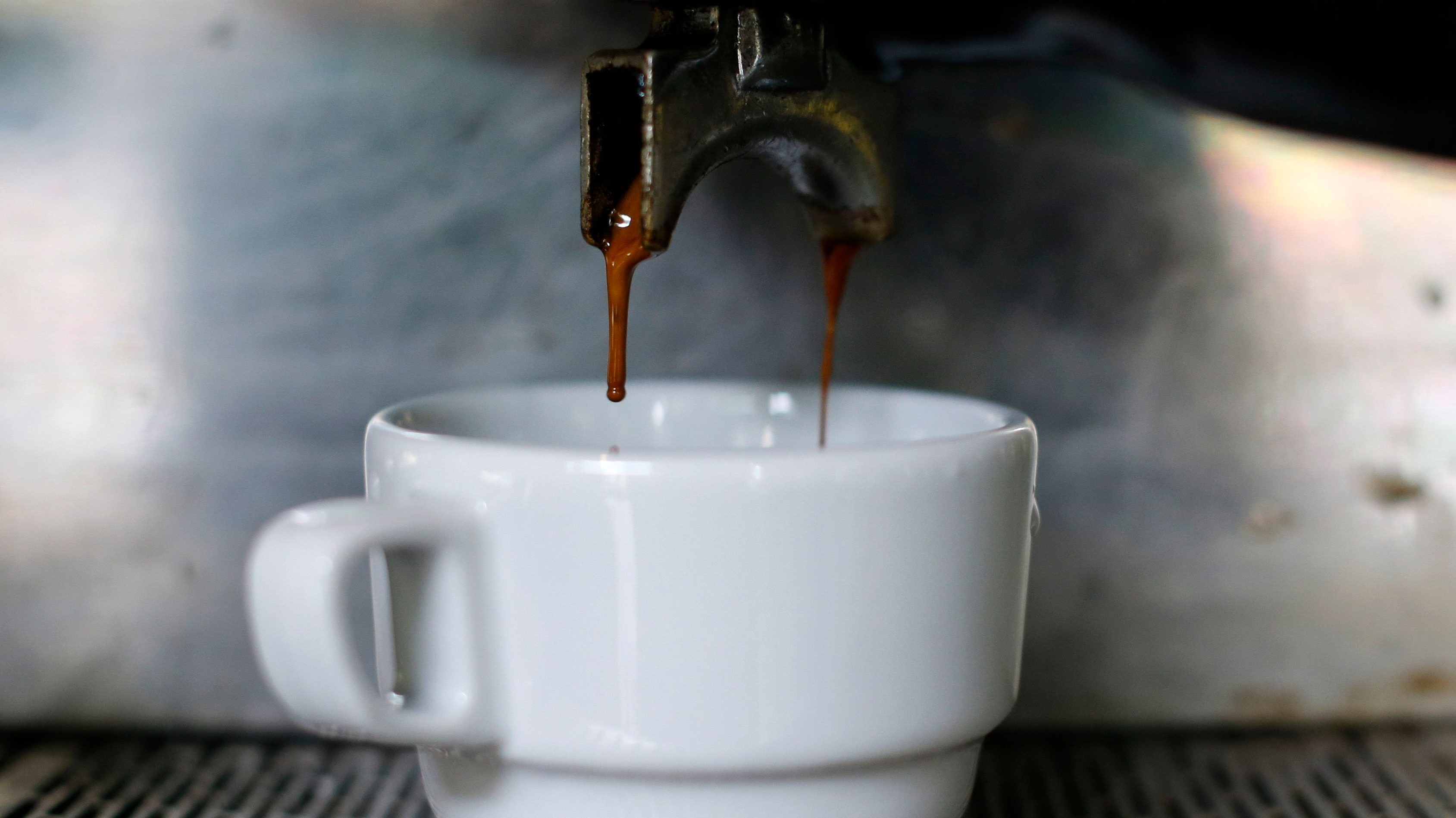 A cup of coffee is served at a coffee shop in Caracas February 26, 2015. Venezuela, once a proud exporter of premium coffee, has been reduced to swapping crude oil for growing volumes of Nicaraguan coffee beans to make sure worsening economic turmoil does not prevent people from getting their caffeine fix. For the first time on record, coffee imports this year will exceed the bean output of Venezuela's centuries-old coffee industry, according to U.S. government estimates. The South American country's shift from net coffee exporter to substantial importer has altered flows in regional markets, boosting prices for some varieties of coffee. Picture taken February 26, 2015. REUTERS/Jorge Silva (VENEZUELA - Tags: SOCIETY FOOD BUSINESS COMMODITIES) - GM1EB3201W601