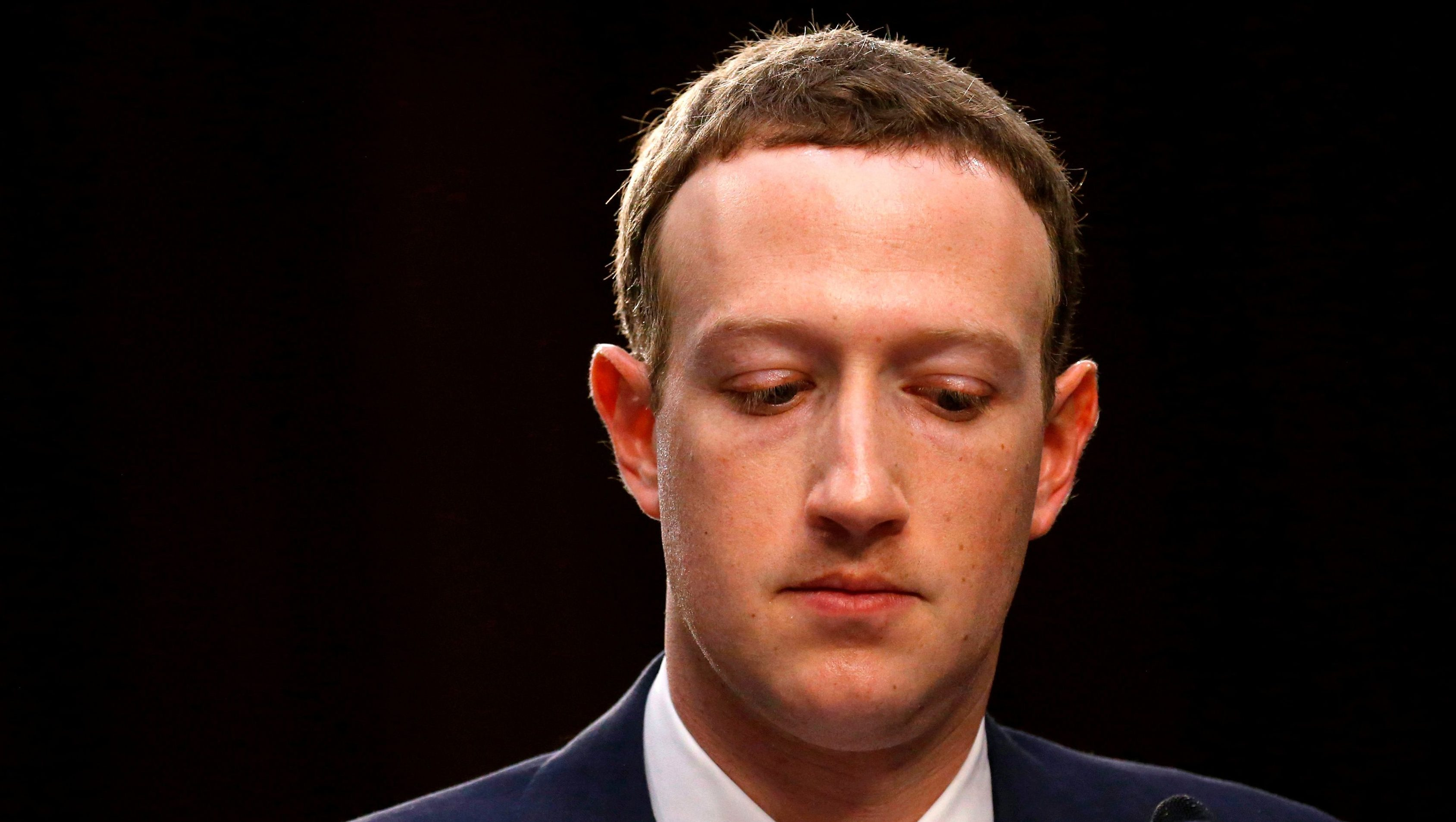 FILE PHOTO: Facebook CEO Mark Zuckerberg listens while testifying before a joint Senate Judiciary and Commerce Committees hearing regarding the company's use and protection of user data, on Capitol Hill in Washington, U.S., April 10, 2018. Picture taken April 10, 2018.  REUTERS/Leah Millis/File Photo - RC12536B96A0