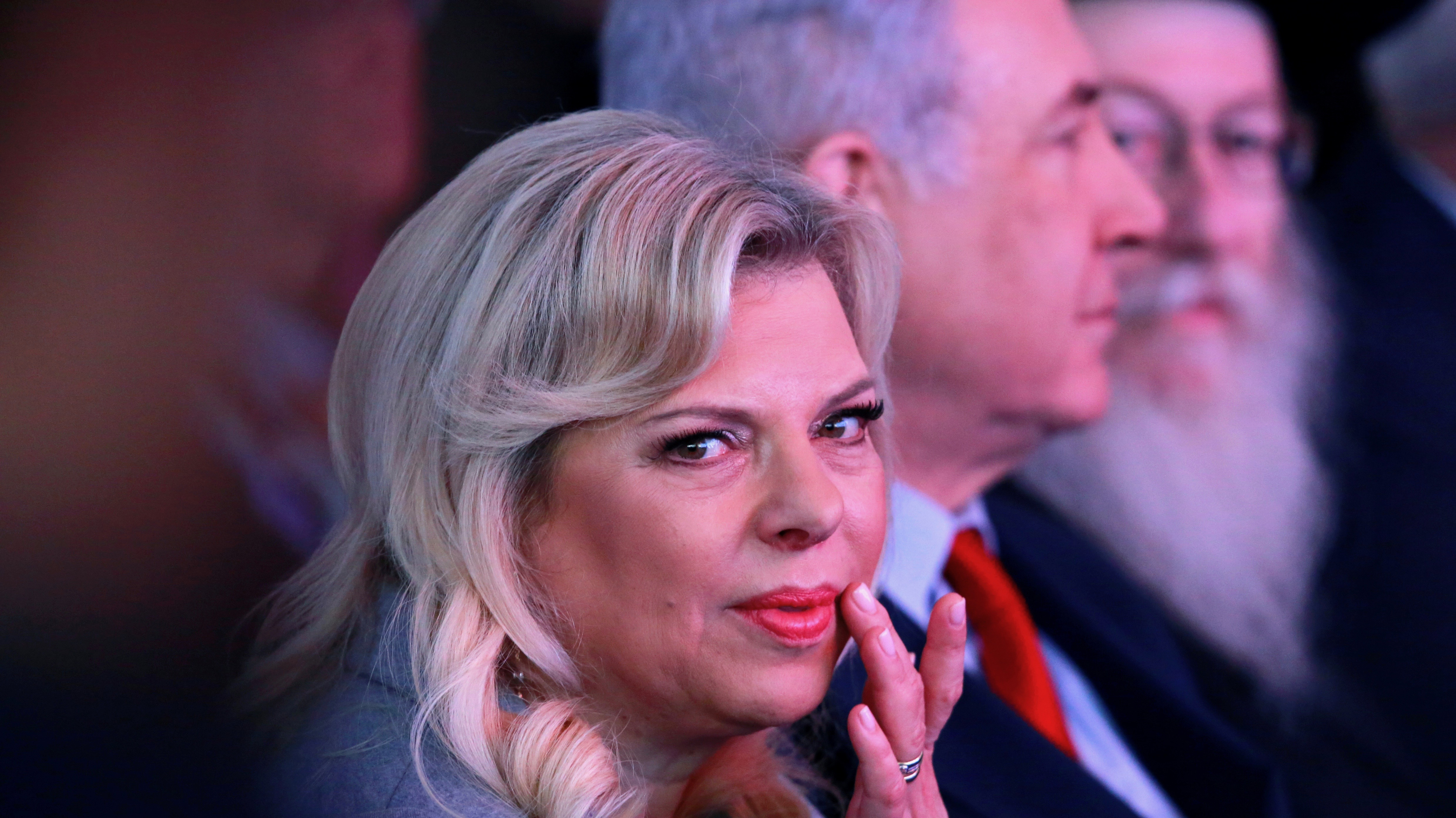 Sara Netanyahu with her husband in the background.