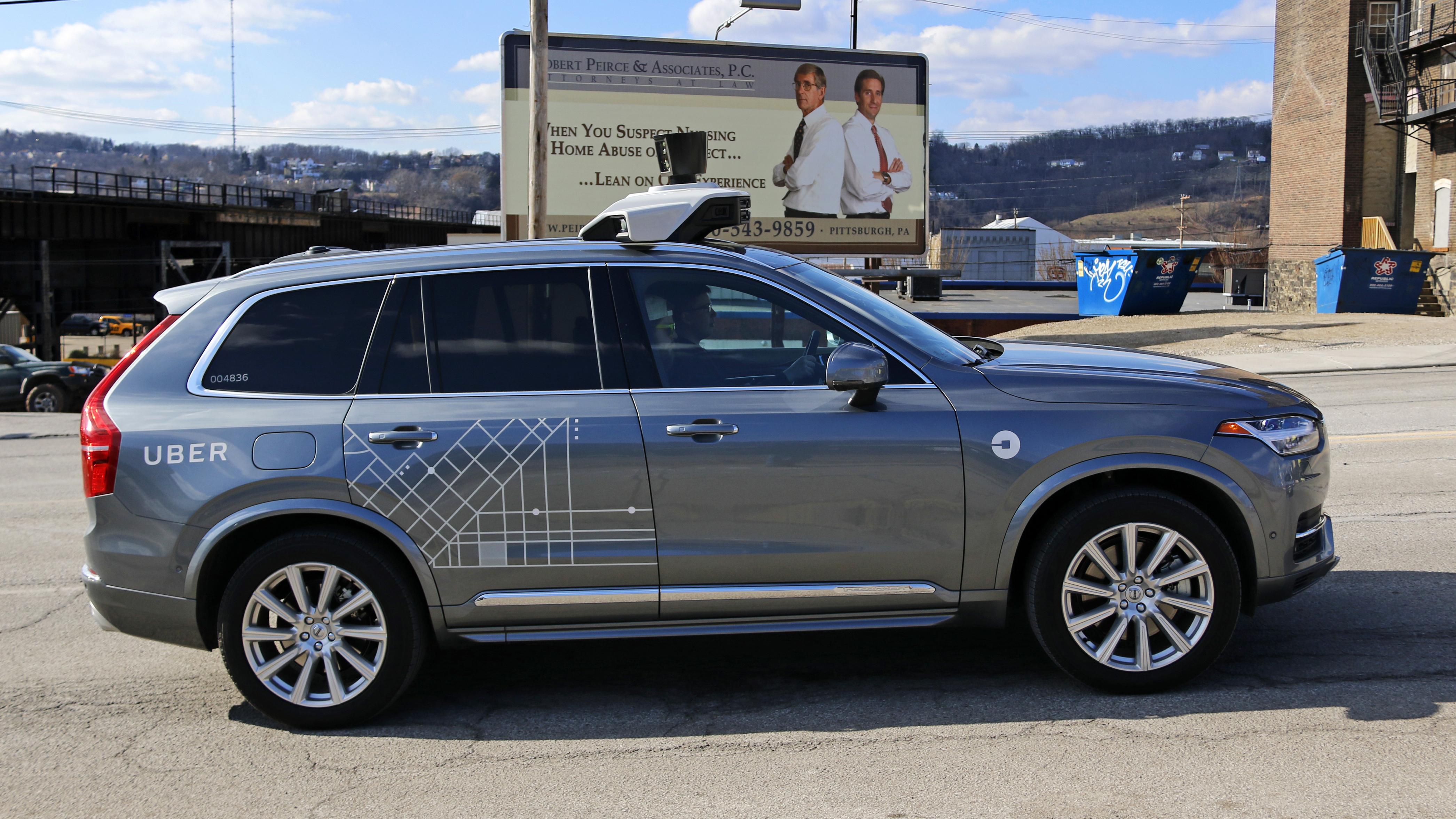An Uber self-driving Volvo drives in Pittsburgh Friday, March 17, 2017. (AP Photo/Gene J. Puskar)
