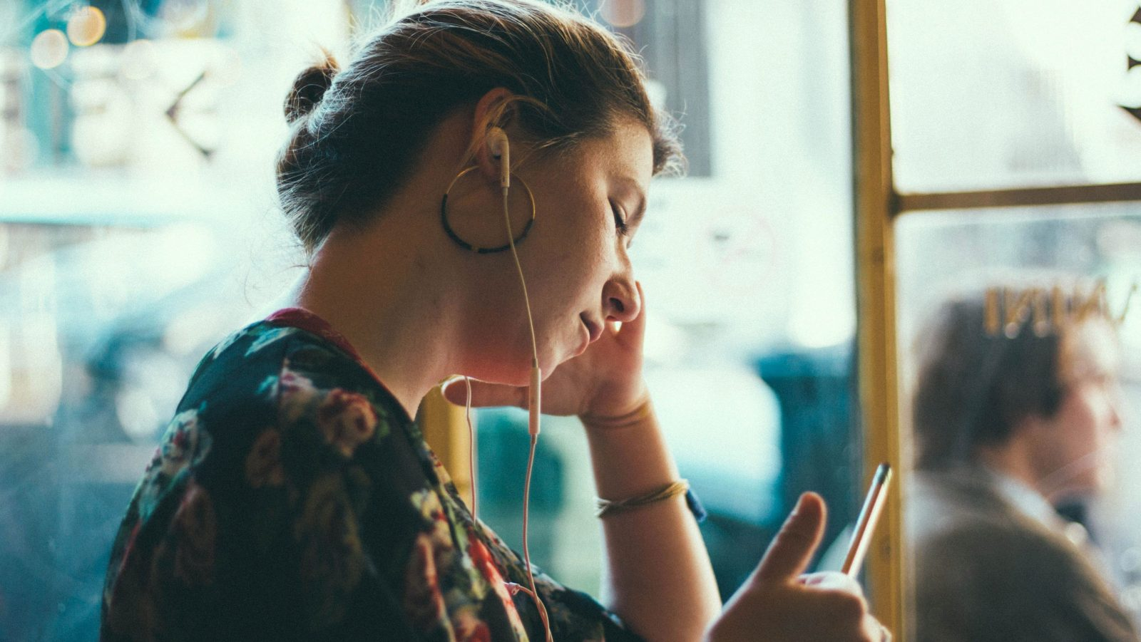 photo of a woman in a cafe, working