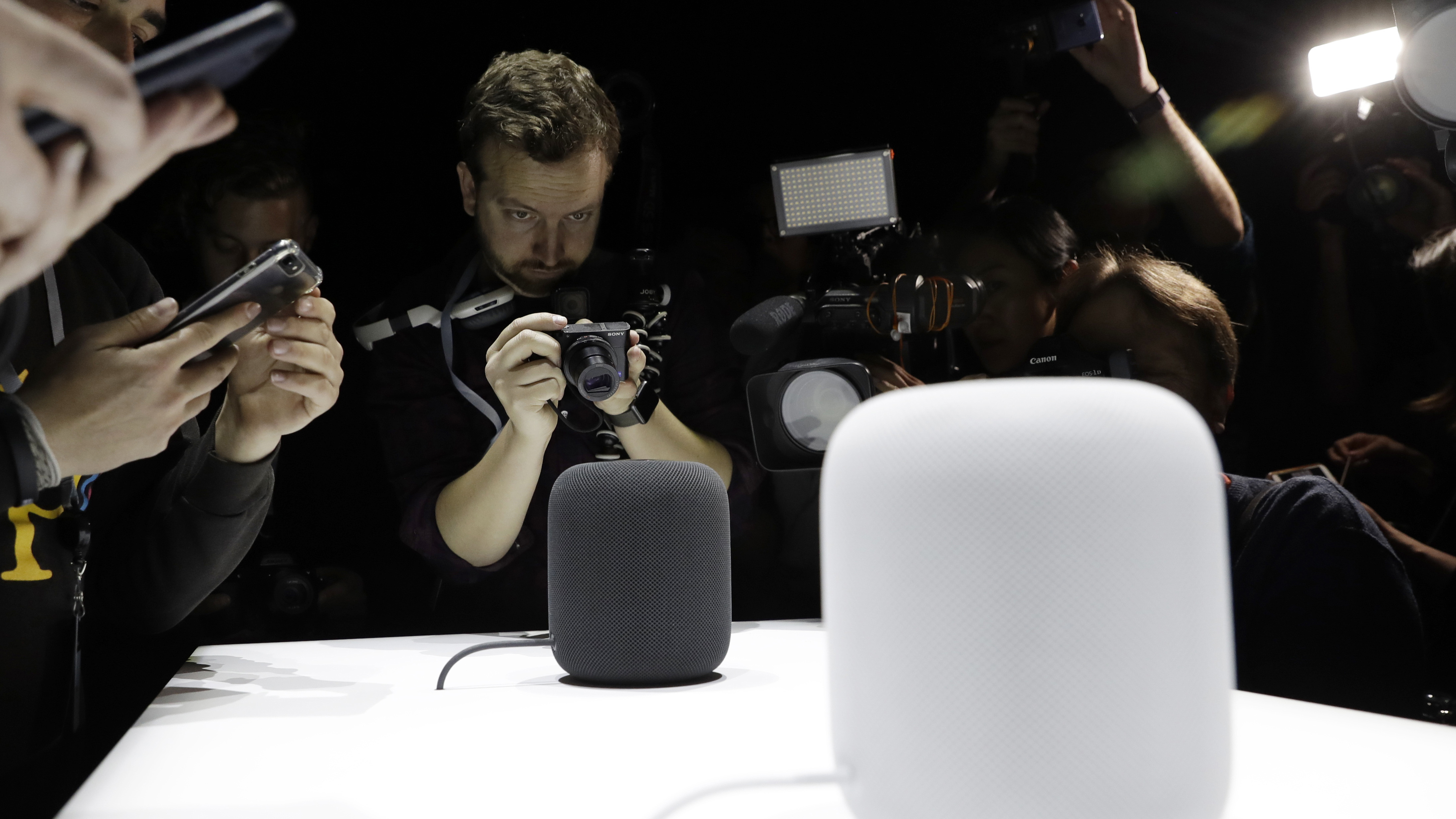 FILE - In this Monday, June 5, 2017, file photo, the HomePod speaker is photographed in a a showroom during an announcement of new products at the Apple Worldwide Developers Conference in San Jose, Calif. Pre-orders for the HomePod will begin Friday, Jan. 26, 2018, in the U.S, U.K. and Australia, two weeks before the speaker goes on sale in stores. (AP Photo/Marcio Jose Sanchez, File)