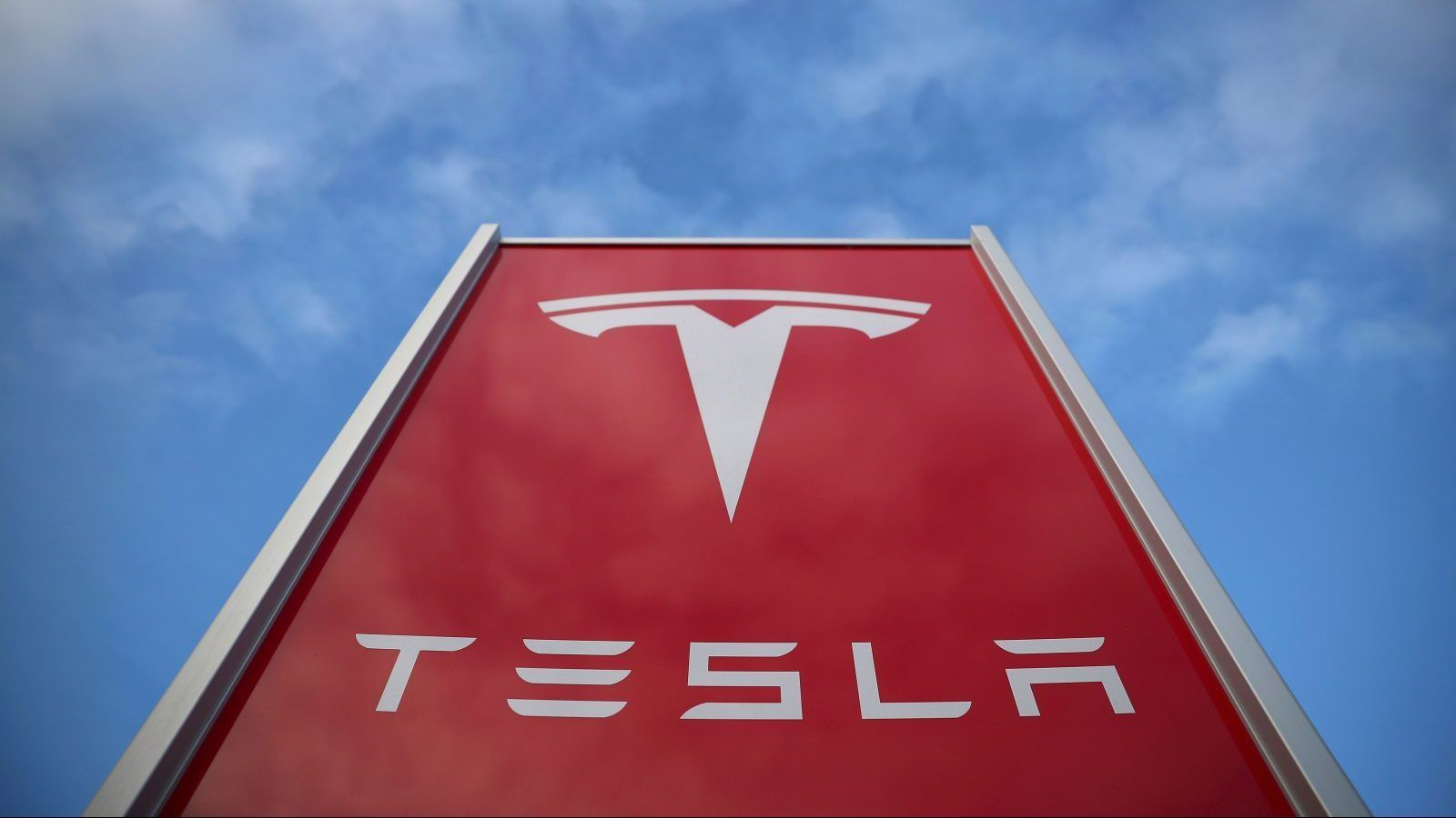 Tesla to lay off 9% of workers as part of restructuring plan