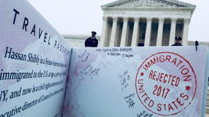 A mock-up of banned Muslim traveler's passport outside the US Supreme Court.