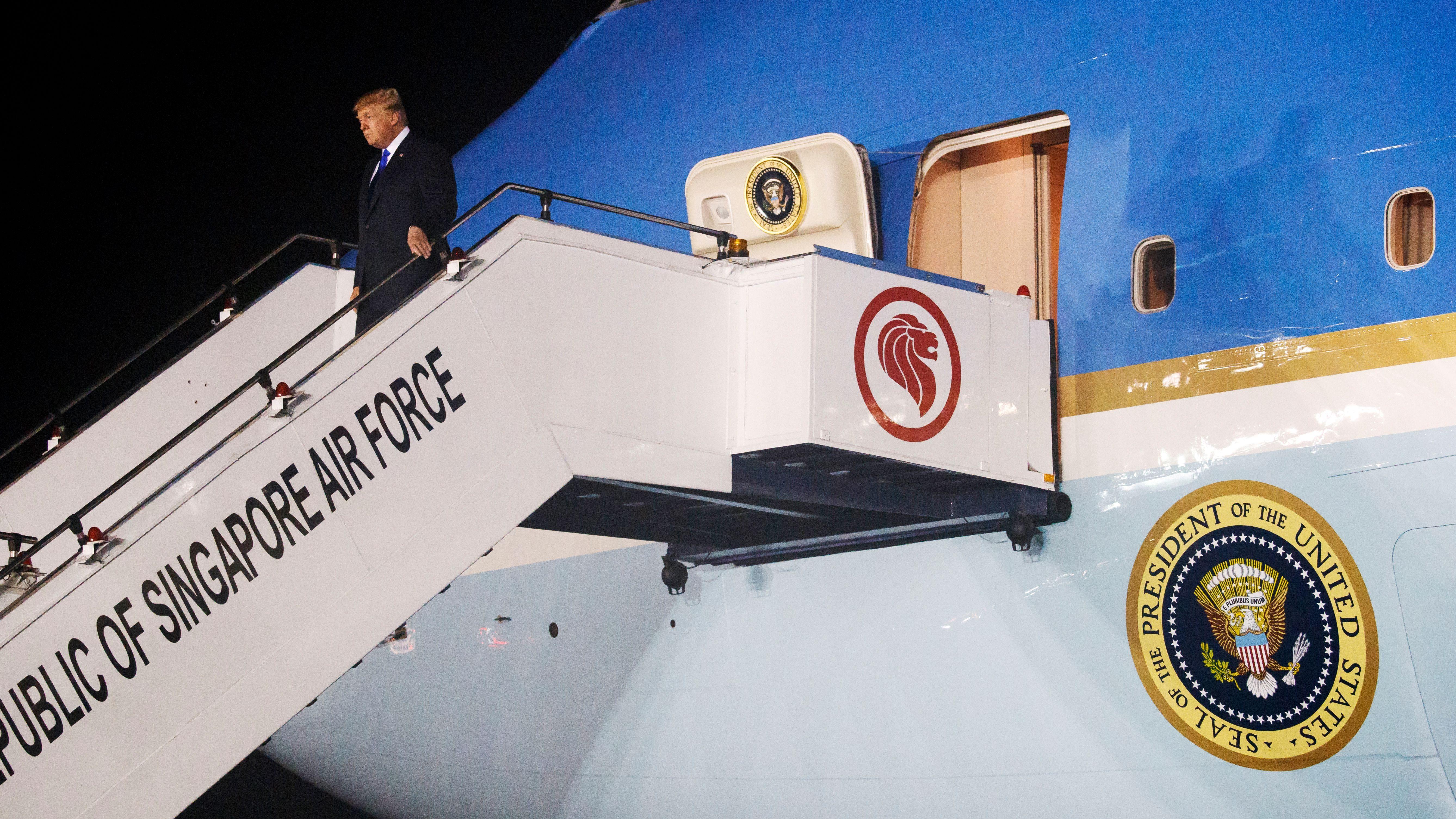 President Donald Trump arrives at Paya Lebar Air Base for a summit with North Korean leader Kim Jong Un, Sunday, June 10, 2018, in Singapore.