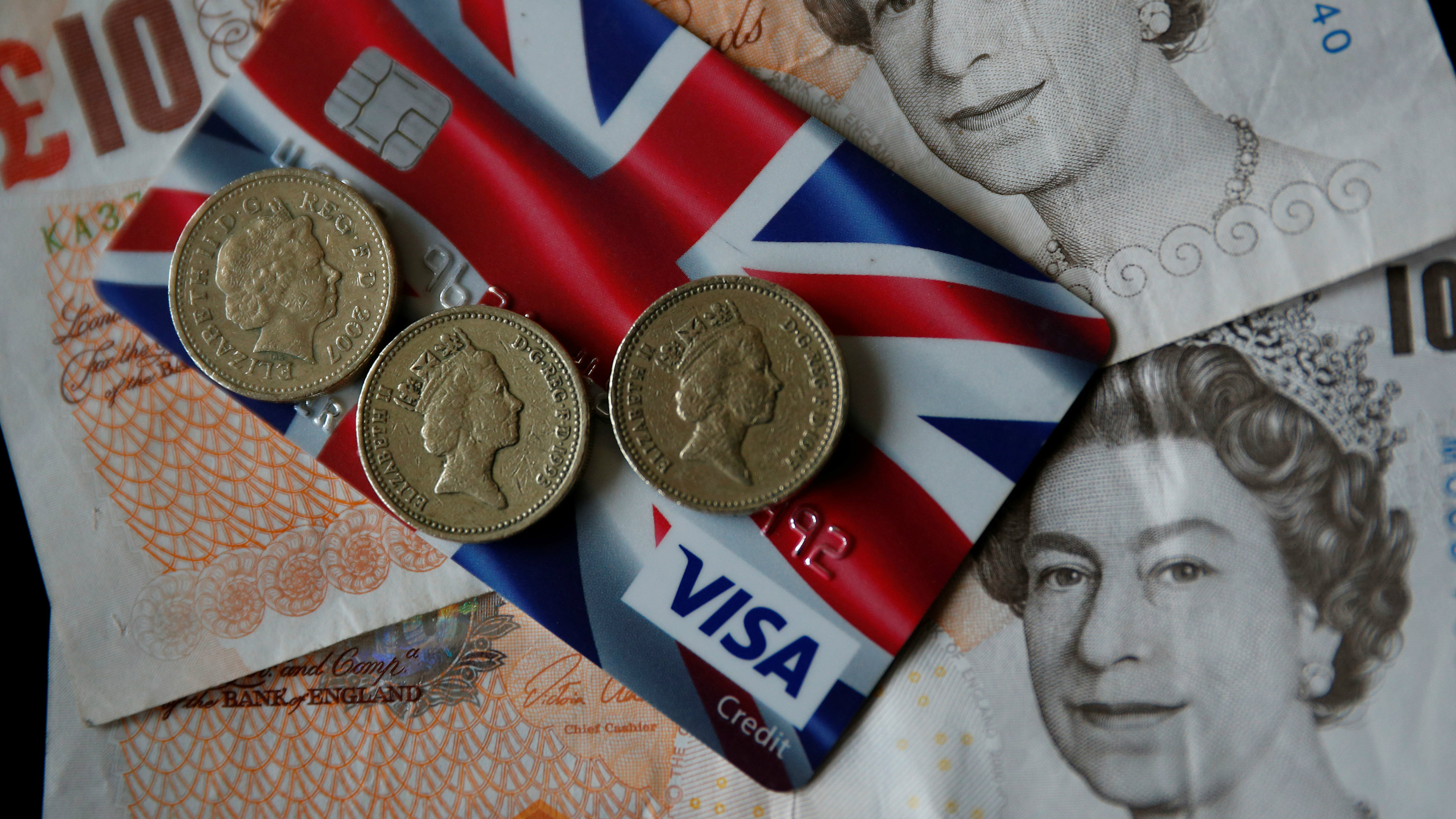 A Union Jack themed Visa credit card is seen amongst British currency in this photo illustration taken in Manchester, Britain March 13, 2017. Picture taken March 13, 2017.