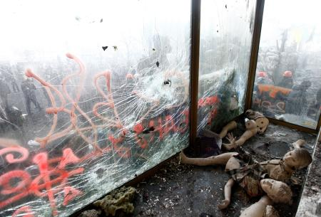 Broken mannequins lie behind a shop front damaged by clashes between anti-government protestors and riot police in Kiev, 2014.