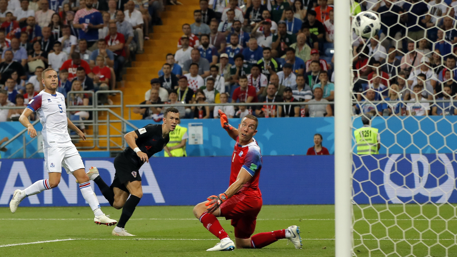 Croatia's Ivan Perisic, center, scores his side's second goal during the group D match between Iceland and Croatia, at the 2018 soccer World Cup in the Rostov Arena in Rostov-on-Don, Russia, Tuesday, June 26, 2018. (AP Photo/Vadim Ghirda)