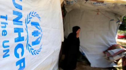 A Syrian refugee woman stands outside a tent at a refugee camp in Zahrani town, southern Lebanon