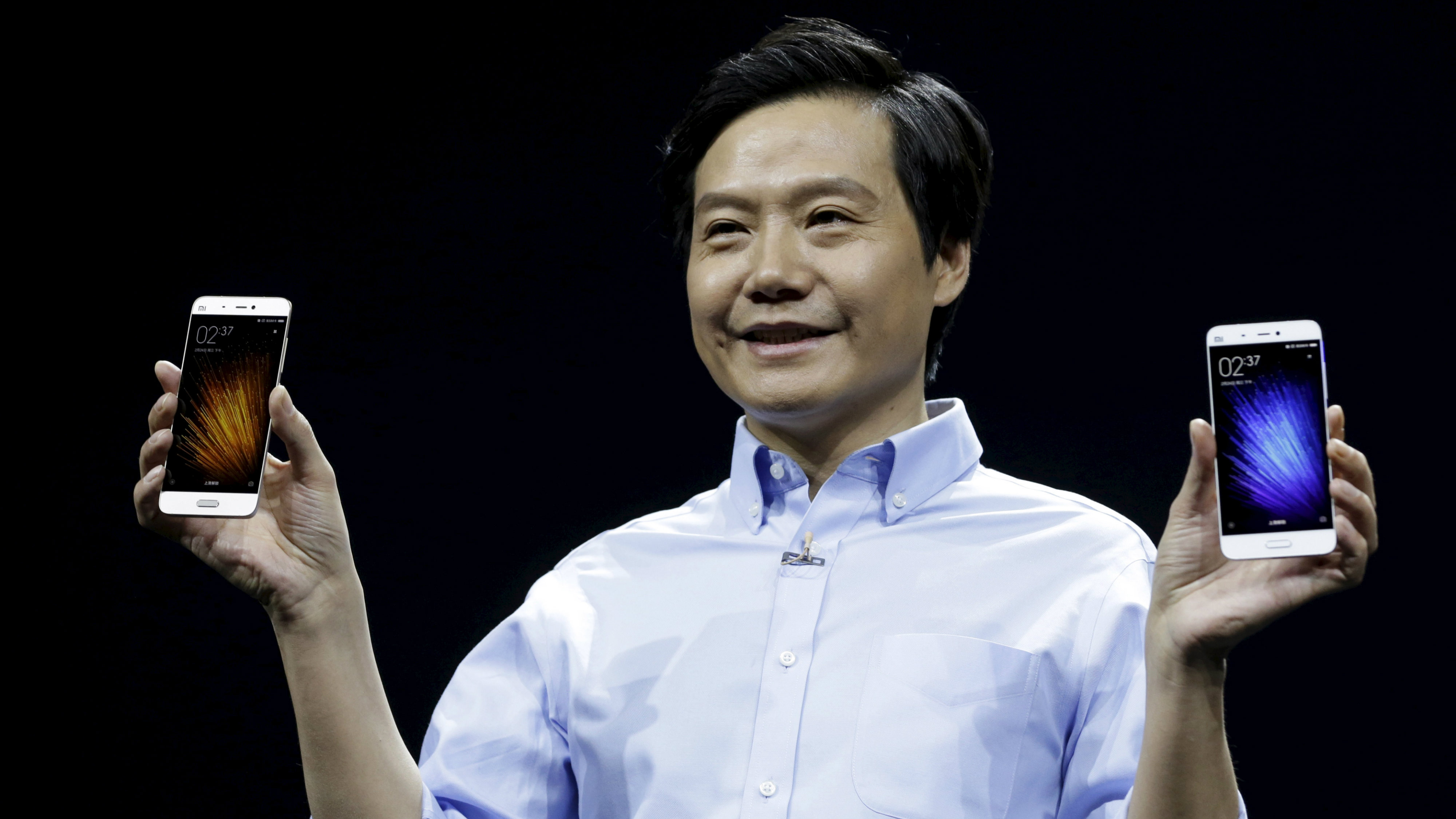Lei Jun, founder and CEO of China's mobile company Xiaomi, displays Xiaomi Mi 5 at its launch ceremony, in Beijing, China, February 24, 2016