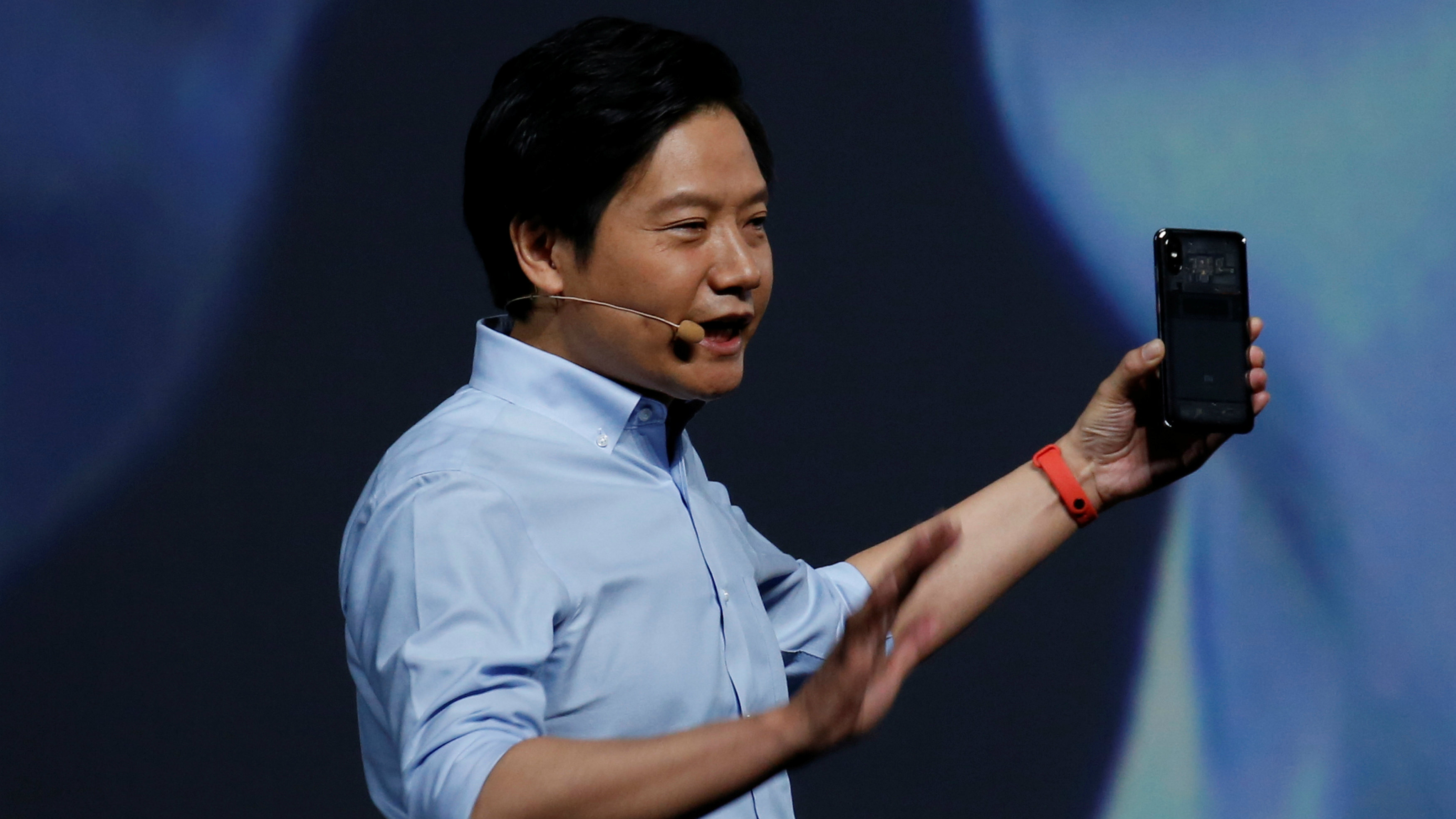 Xiaomi founder Lei Jun introduces the flagship Mi 8 transparent Explorer Edition during a product launch in Shenzhen, China May 31, 2018