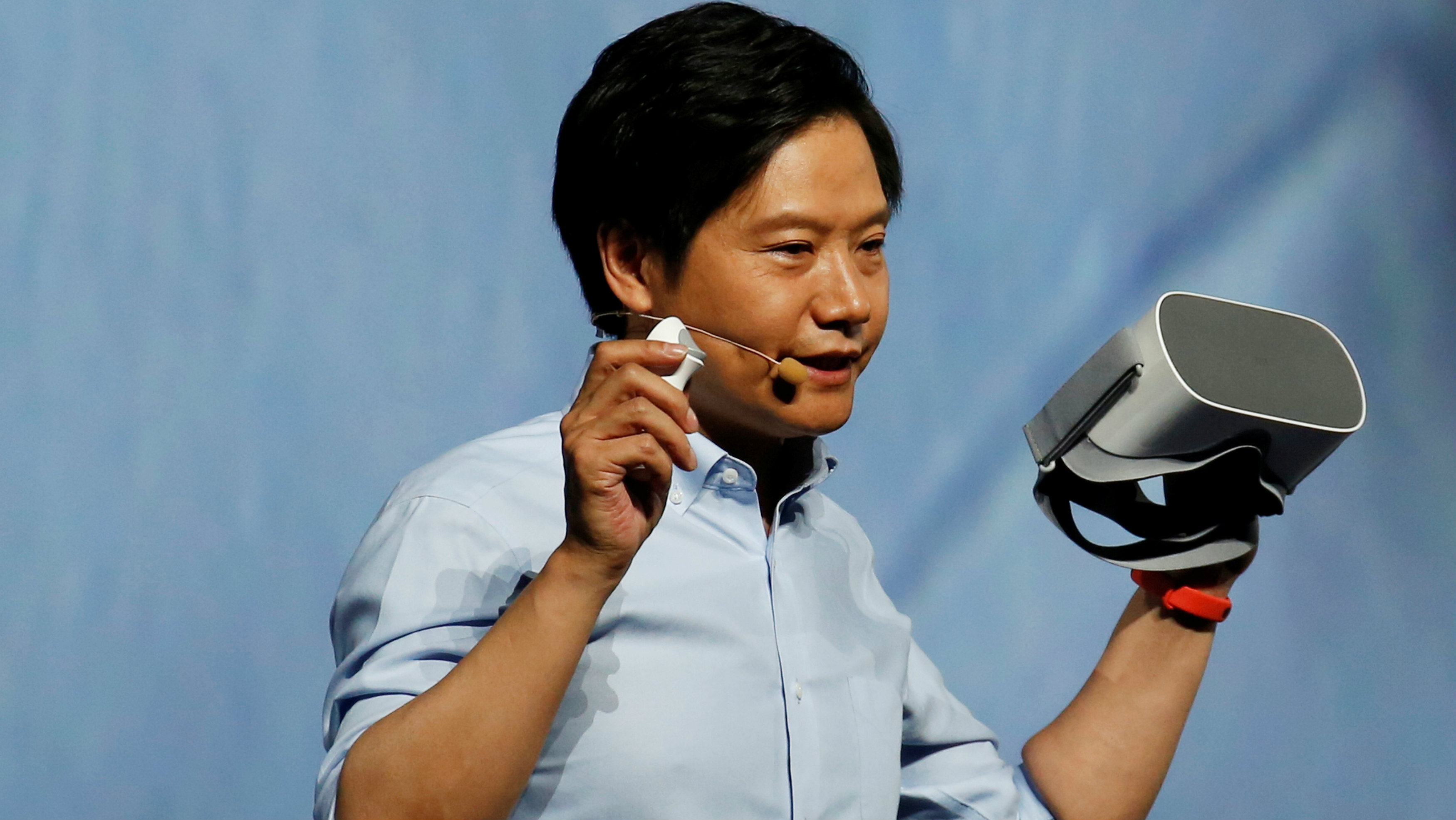 Xiaomi founder Lei Jun holds a new VR headset during a product launch in Shenzhen, China