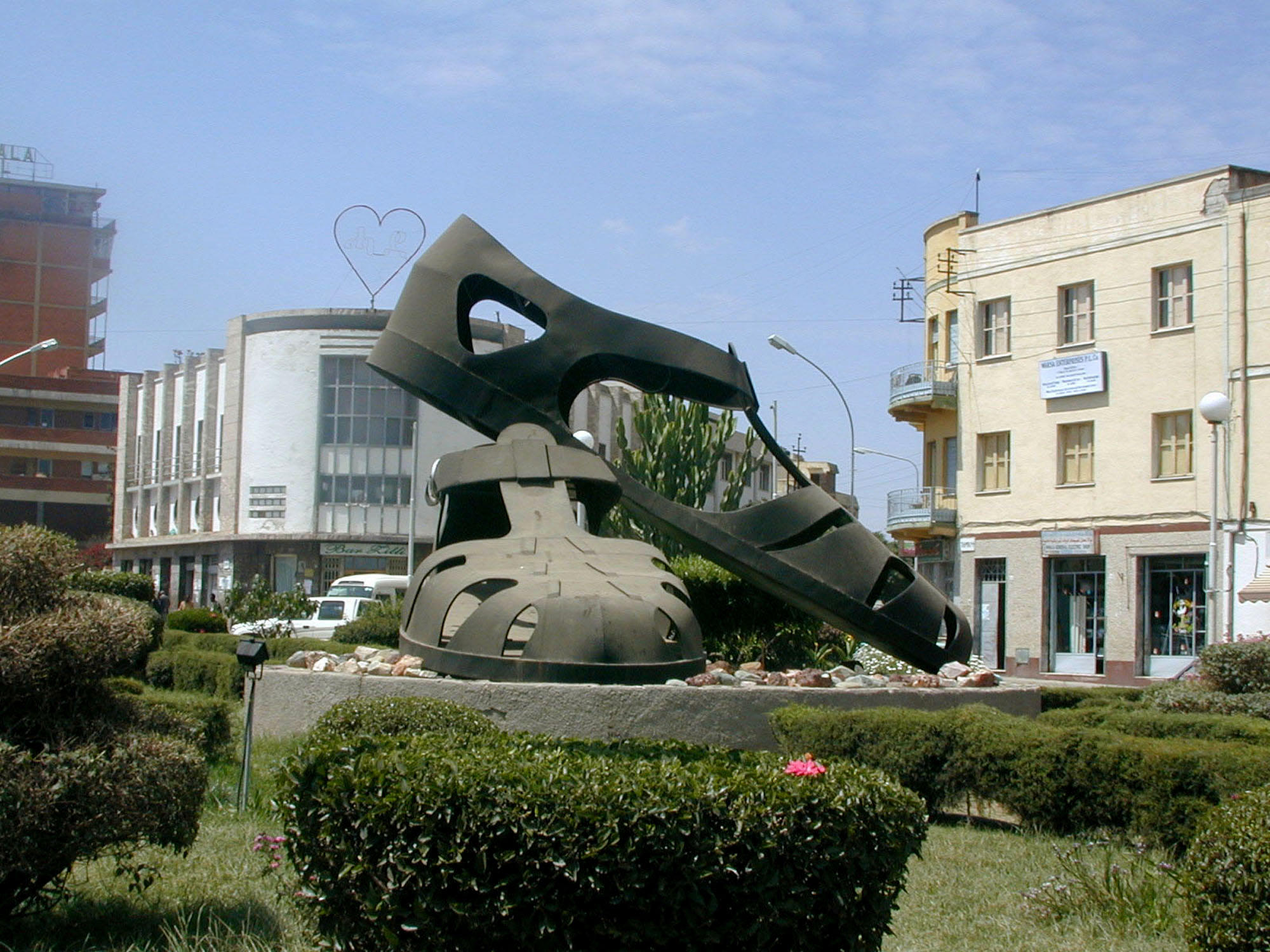 Traffic moves around a sculpture of a giant pair of sandals which has been built on a roundabout in the center of Asmara, Eritrea, Oct. 11, 2001. The sandals are the latest monument to the 30-year war Eritreans endured to win independence from neighboring Ethiopia.