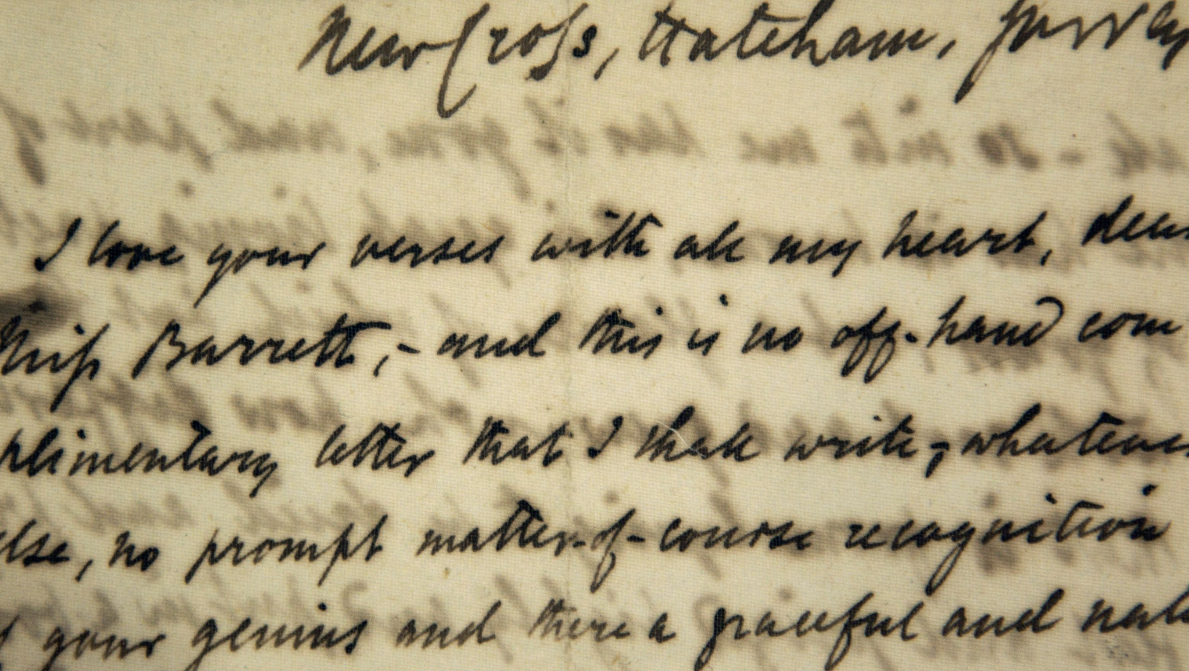 """This Friday, Feb. 10, 2012 photo shows a detail of the first love letter sent by poet Robert Browning to poet Elizabeth Barrett in January of 1845, on display at the Margaret Clapp Library on the campus of Wellesley College, in Wellesley, Mass. The letter begins: """"I love your verses with all my heart, dear Miss Barrett."""" Beginning Valentine's Day Feb. 14, 2012 the famous love letters of Elizabeth Barrett and Robert Browning will be available on line as part of a digitization collaboration between Wellesley and Baylor University in Texas. (AP Photo/Steven Senne)"""