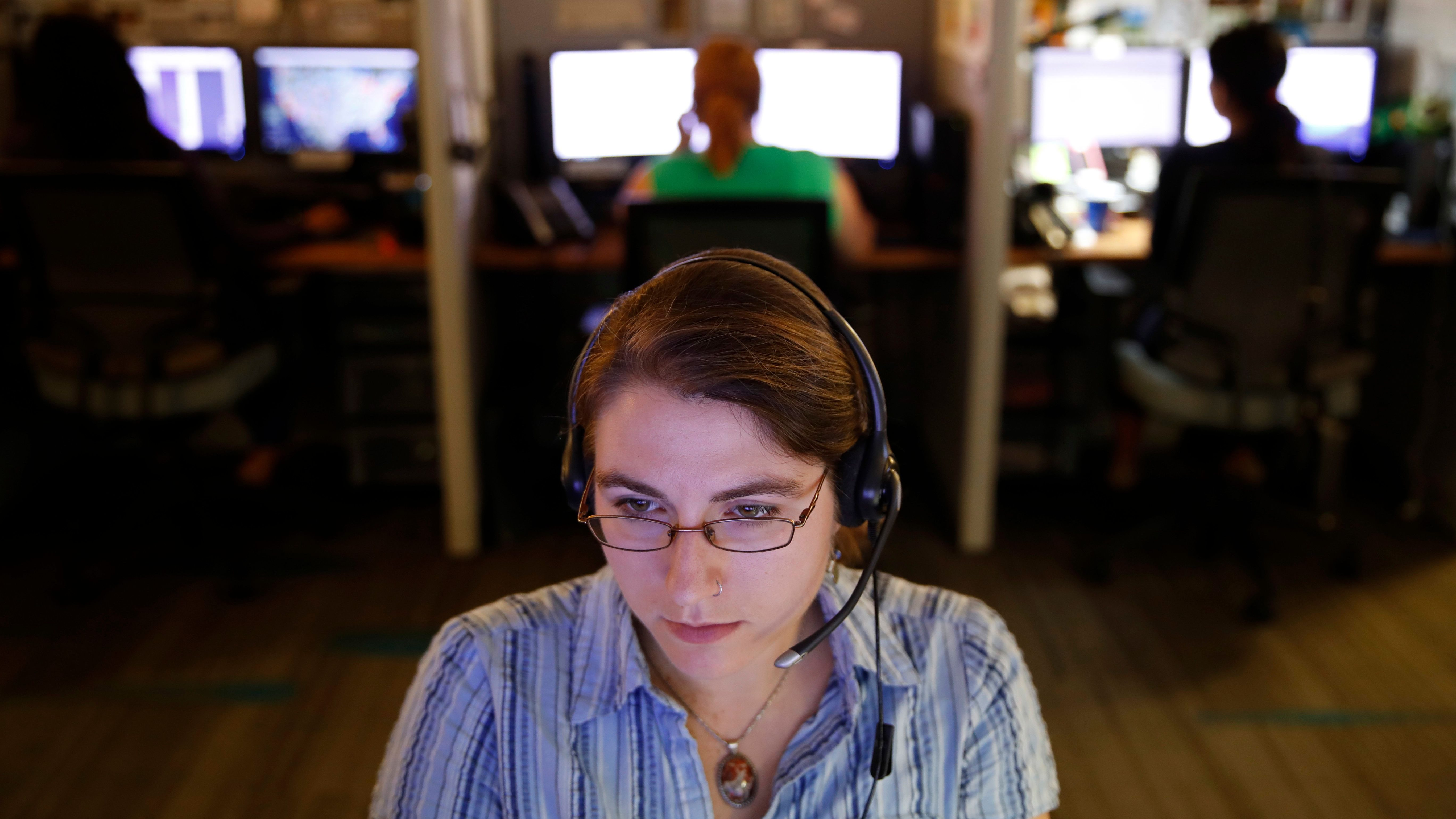 A hotline advocate takes a call from a potential victim of trafficking while working at the Human Trafficking Hotline call center, Tuesday, Sept. 26, 2017, in Washington. People in the anti-trafficking field say it performs well at two vital roles _ as a conduit for people to report suspected trafficking and as an immediate resource for trafficking victims in need of help. (AP Photo/Jacquelyn Martin)