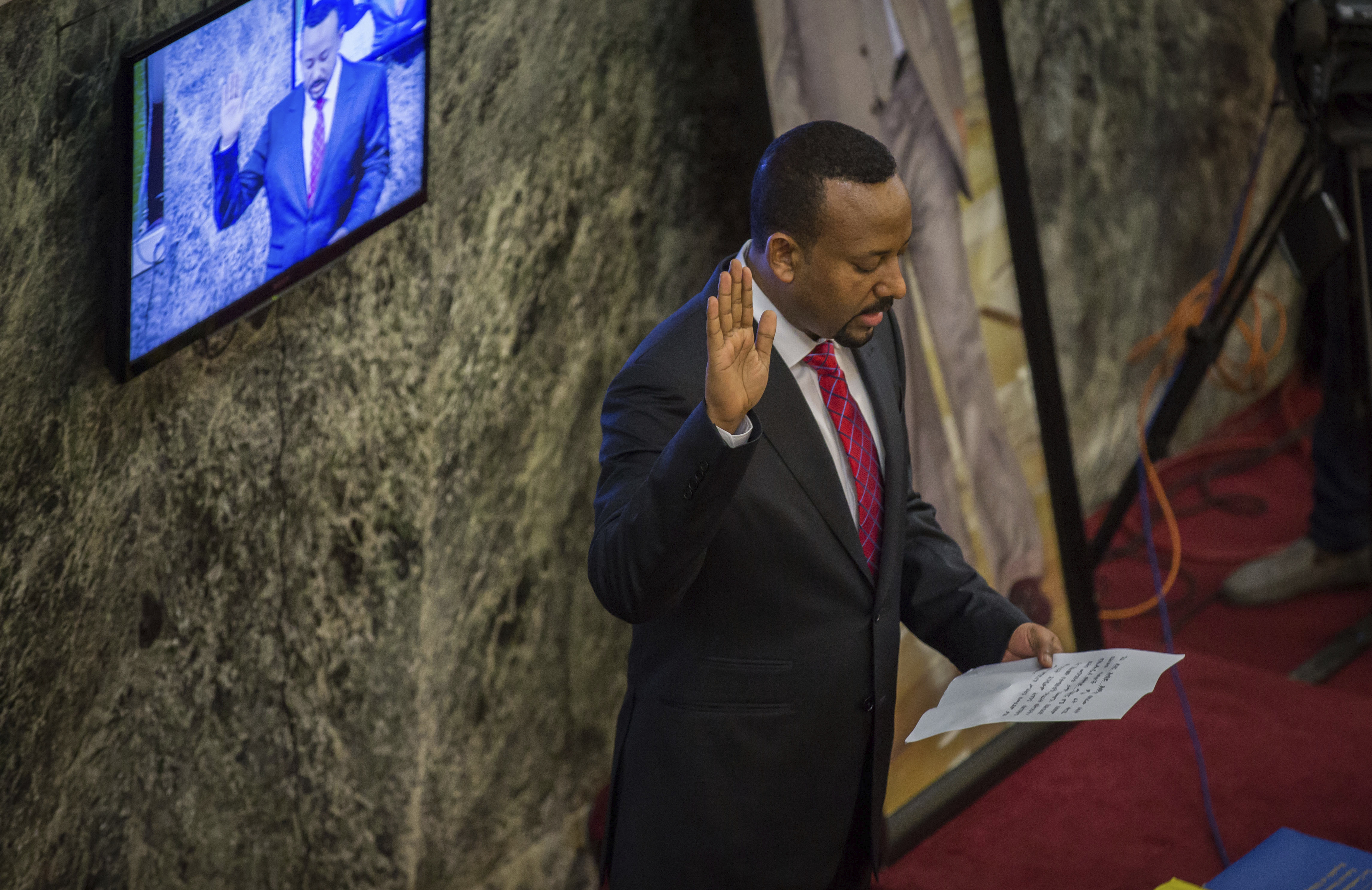 Abiy Ahmed, the newly elected chair of the Ethiopian Peoples' Revolutionary Democratic Front (EPRDF) is sworn in as the country's Prime Minister, Monday, April 2, 2018. Ethiopia's legislature has elected young and outspoken Abiy Amhed as prime minister, amid hopes that he will be able to quell sustained anti-government protests in Africa's second most populous nation.