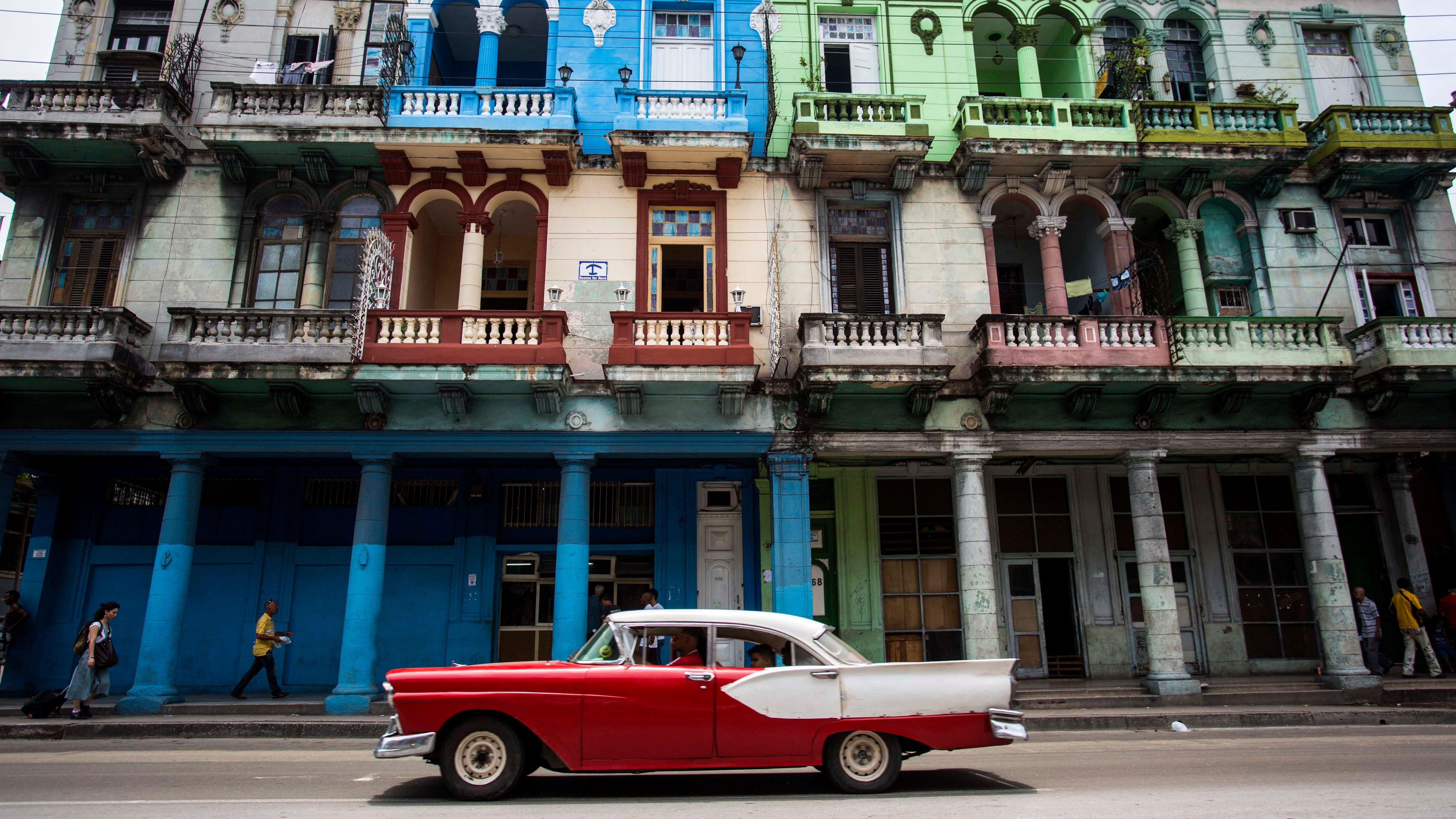 A man drives a classic America car past a row of multi-colored facades on Infantas Street in Havana, Cuba, Saturday, June 2, 2018. Cuban legislators took the first step Saturday toward drafting a new constitution.