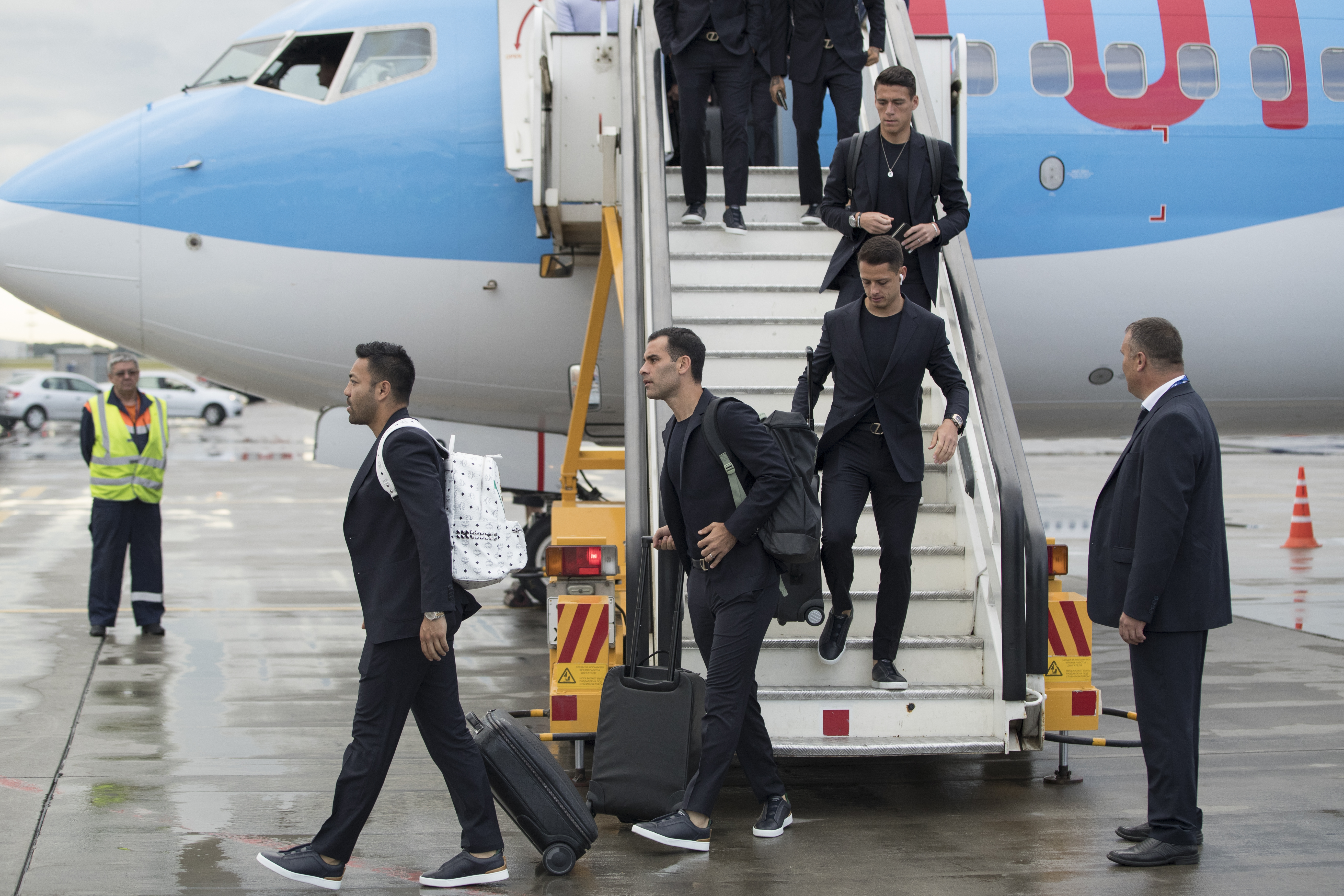 Rafael Marquez, center left, Javier Hernandez, center right, and their teammates disembark the plane as the Mexico national soccer team arrive at the Sheremetyevo international airport, outside Moscow, Russia, Monday, June 11, 2018 to compete in the 2018 World Cup in Russia. The 21st World Cup begins on Thursday, June 14, 2018, when host Russia takes on Saudi Arabia. (AP Photo/Pavel Golovkin)