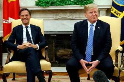 President Donald Trump winks at reporters during a meeting with Dutch Prime Minister Mark Rutte in the Oval Office of the White House, Monday, July 2, 2018, in Washington.