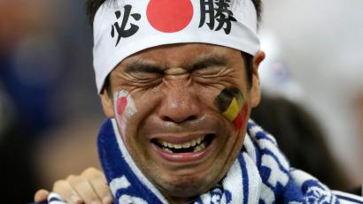 A Japan supporters cries after losing the round of 16 match between Belgium and Japan at the 2018 soccer World Cup in the Rostov Arena, in Rostov-on-Don, Russia, Monday, July 2, 2018.