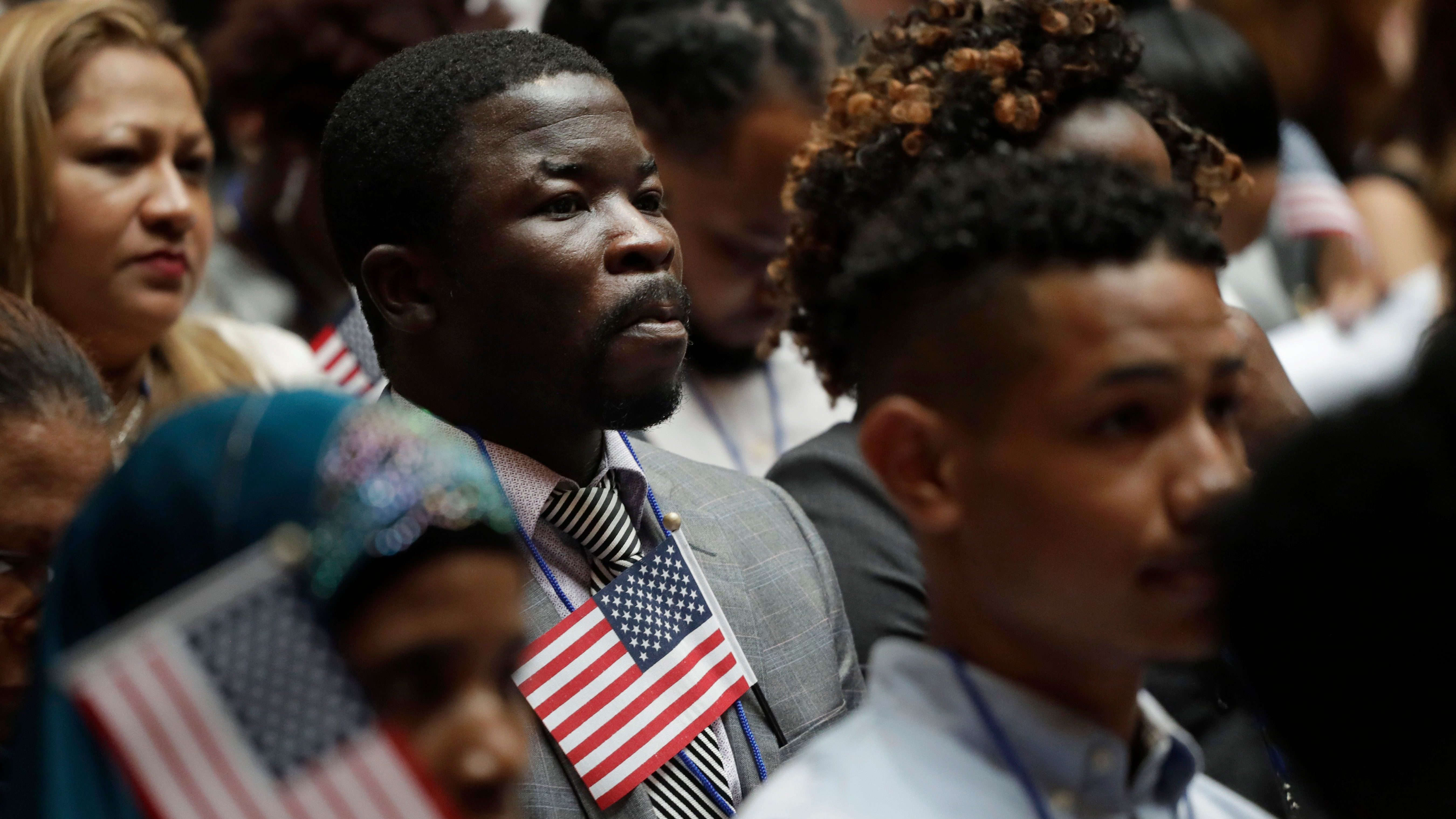 An unidentified man listens during a US naturalization ceremony