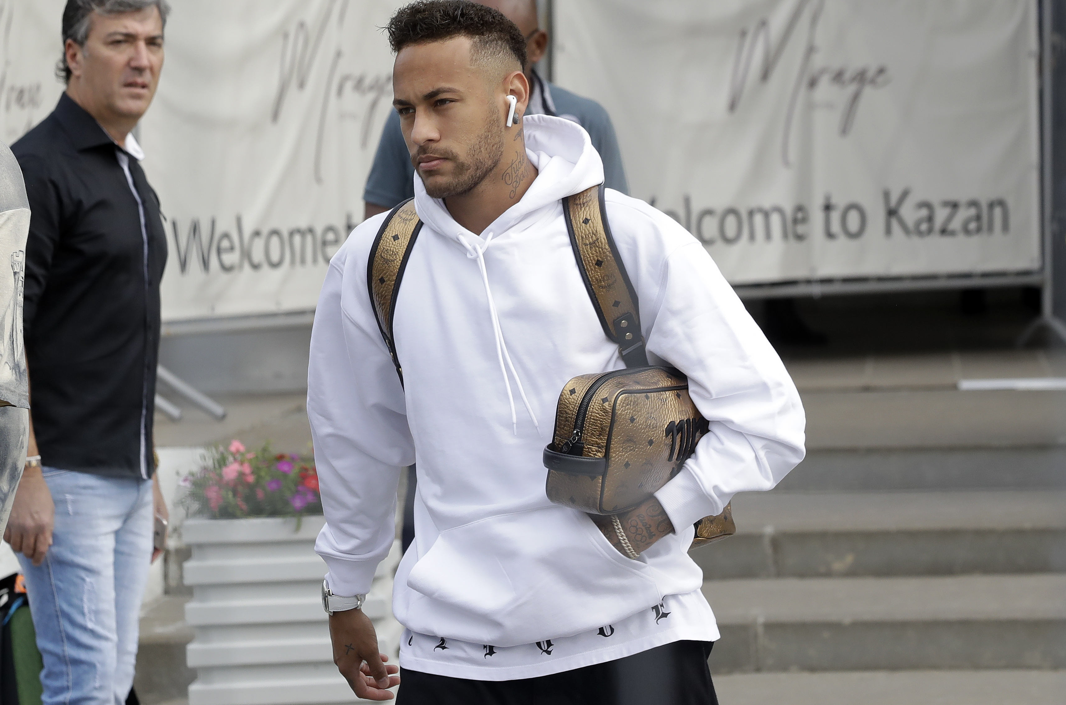 Brazil's Neymar leaves the hotel to board a bus in his way to the airport Airport in Kazan, Russia, Saturday, July 7, 2018. Brazil lost the quarterfinal against Belgium and leave the soccer World Cup. (AP Photo/Andre Penner)