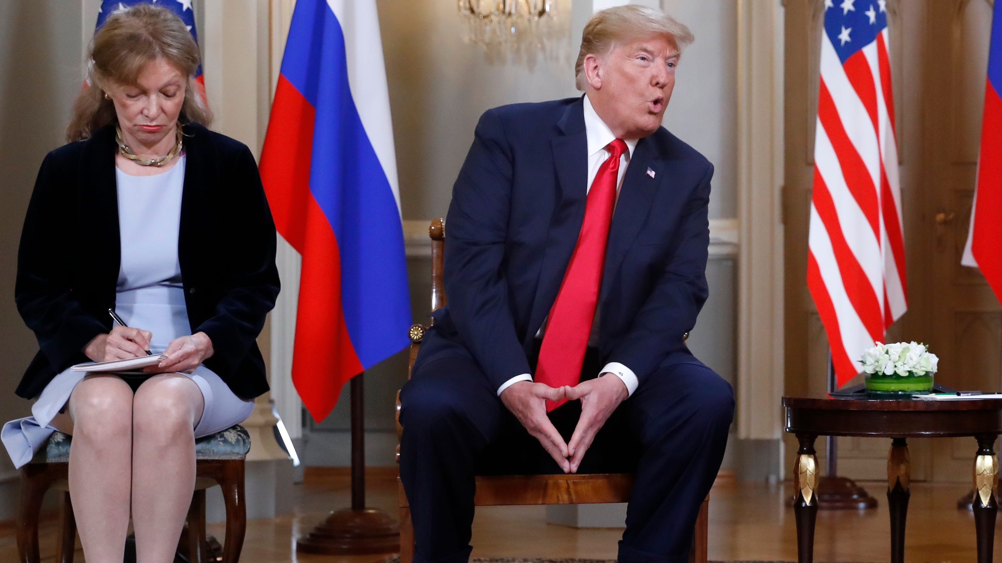 Marina Gross, left, takes notes when U.S. President Donald Trump talks to Russian President Vladimir Putin at the beginning of their one-on-one-meeting at the Presidential Palace in Helsinki, Finland, Monday, July 16, 2018. (AP Photo/Pablo Martinez Monsivais)