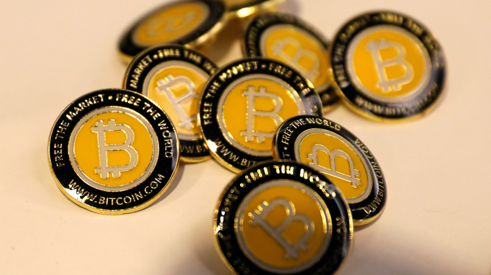 Bitcoin.com buttons are seen displayed on the floor of the Consensus 2018 blockchain technology conference in New York City, New York, U.S., May 16, 2018.