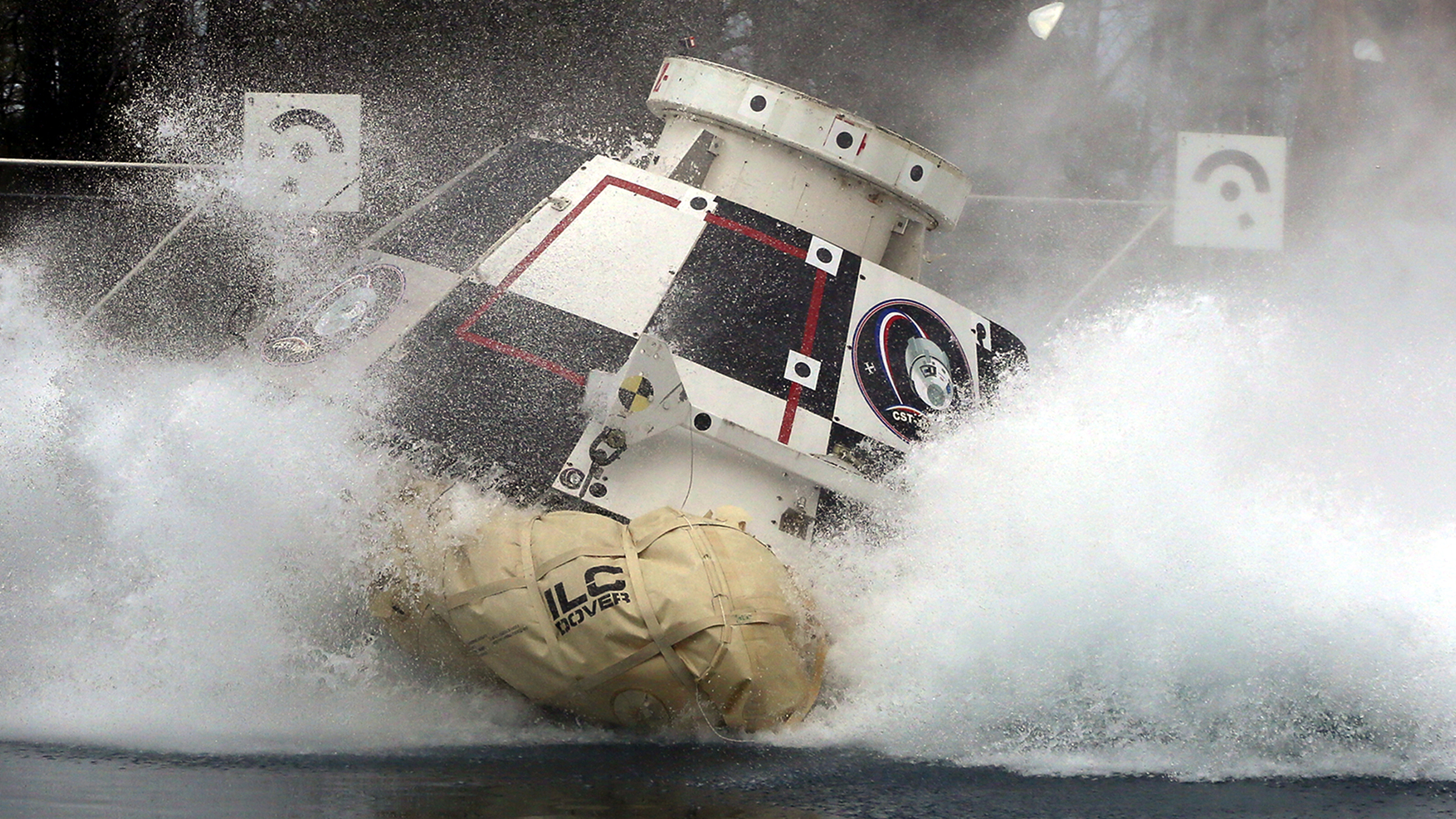 In this Feb. 9, 2016 photo made available by NASA, a mockup of Boeing's CST-100 Starliner spacecraft, in development in partnership with NASA's Commercial Crew Program, splashes into a 20-foot-deep basin at NASA's Langley Research Center in Hampton, Va., during testing of the spacecraft's landing systems design. On Wednesday, July 11, 2018, the U.S. Government Accountability Office said NASA needs a backup plan for getting astronauts to space, given additional delays on the horizon for new commercial crew capsules.