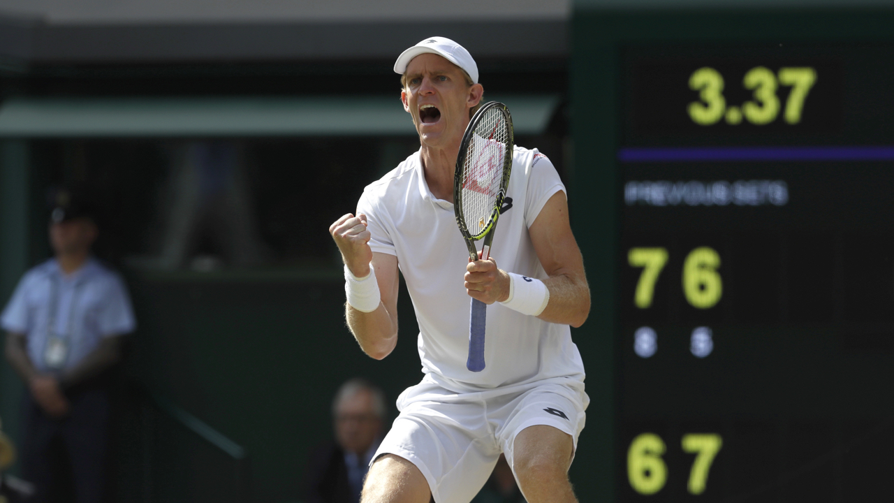 South Africa's Kevin Anderson celebrates breaking serve during his men's singles semifinals match against John Isner of the United States, at the Wimbledon Tennis Championships, in London, Friday July 13, 2018.(AP Photo/Kirsty Wigglesworth)