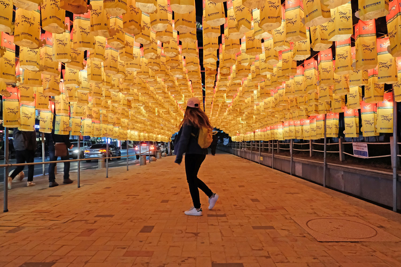 Walking under paper lanterns