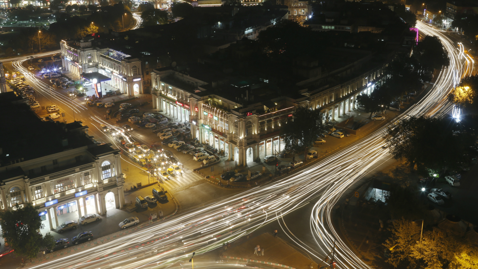 Vehicles move along New Delhi's Connaught Place during evening hours, October 28, 2014. India has the world's deadliest roads, the result of a flood of untrained drivers, inadequate law enforcement, badly maintained highways and cars that fail modern crash tests. Alarmed by the increasing fatalities, the new government has begun a five-year project to cut road deaths by a fifth every year, part of the most ambitious overhaul of highway laws since independence in 1947. Picture taken October 28, 2014. To match Feature INDIA-DRIVING/ Picture is taken using slow shutter speed.