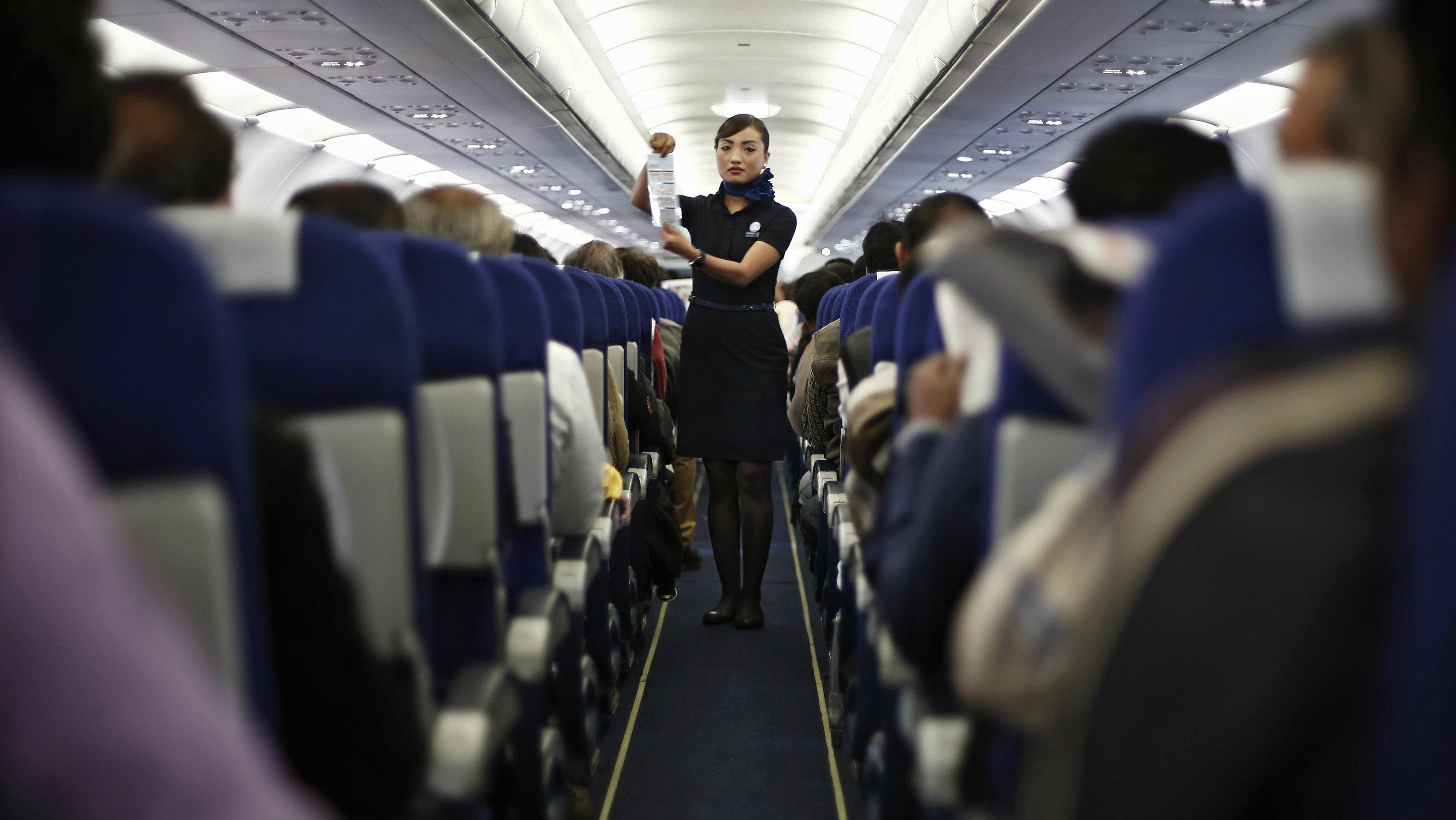 Flight attendant in the aisle