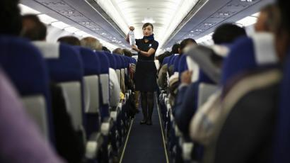Flight attendant in the aisle