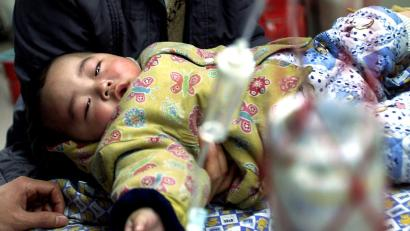 A Chinese child receives a free vaccination for hepatitis B at a local hospital in Guangzhou, the capital of China's southern Guangdong province January 6, 2002. The government began giving free hepatitis B vaccinations to newborn babies this year in Guangdong province, where 20 per cent of the population is infected with the disease.