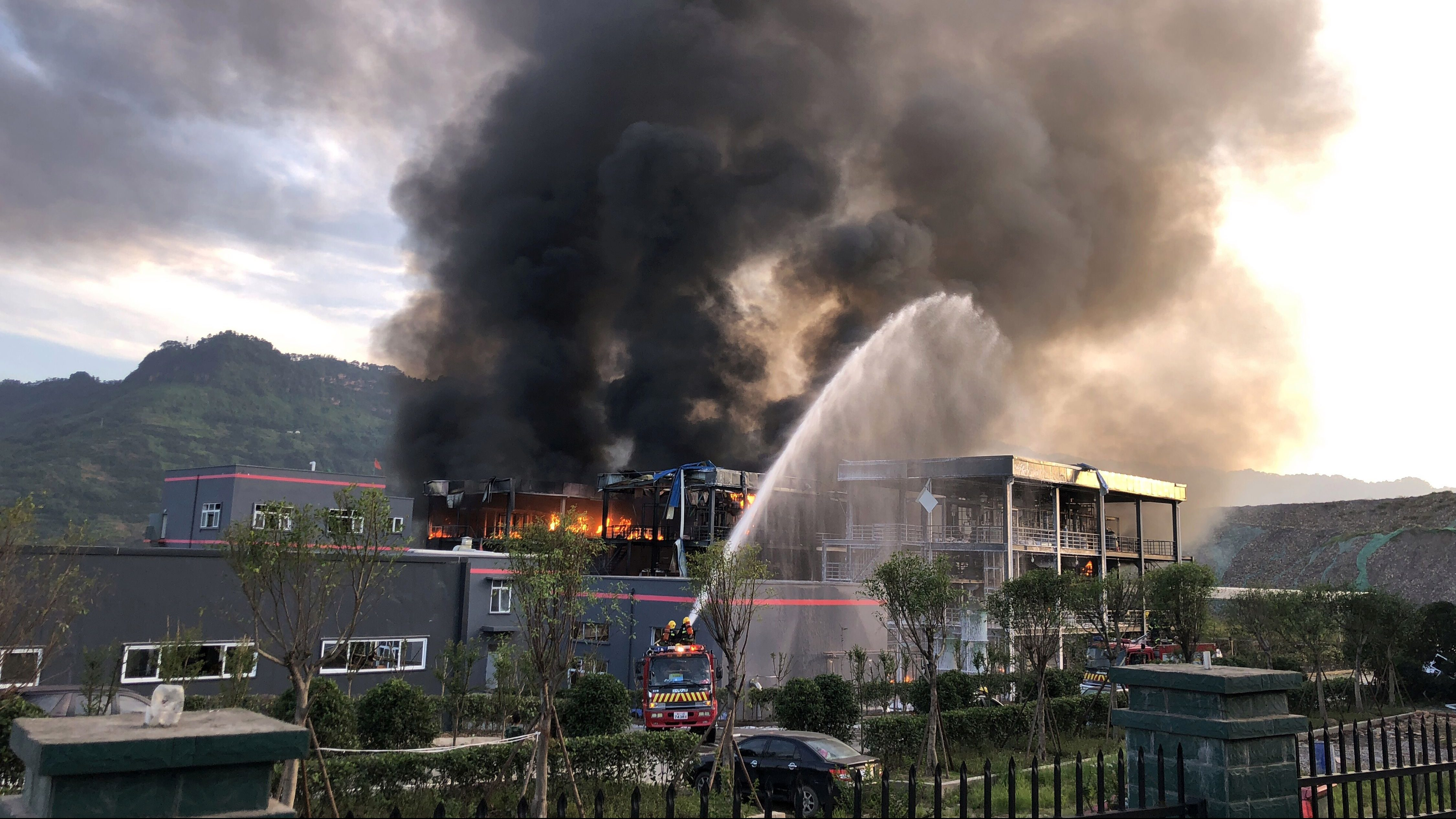 Rescue workers try to put out a fire after an explosion at a chemical plant inside an industrial park in Yibin, Sichuan province, China July 12, 2018.