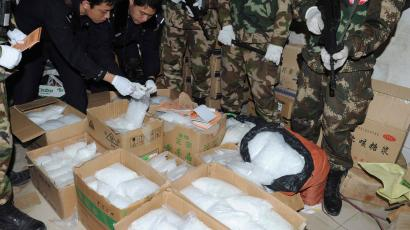 Police check seized crystal meth at Boshe village, Lufeng, Guangdong province, December 29, 2013. According to Xinhua News Agency, Lufeng provided one-third of the crystal meth nationwide over the past three years. Police seized three tonnes of crystal meth and arrested 182 suspects for producing and trafficking drug during the action. Picture taken December 29, 2013.