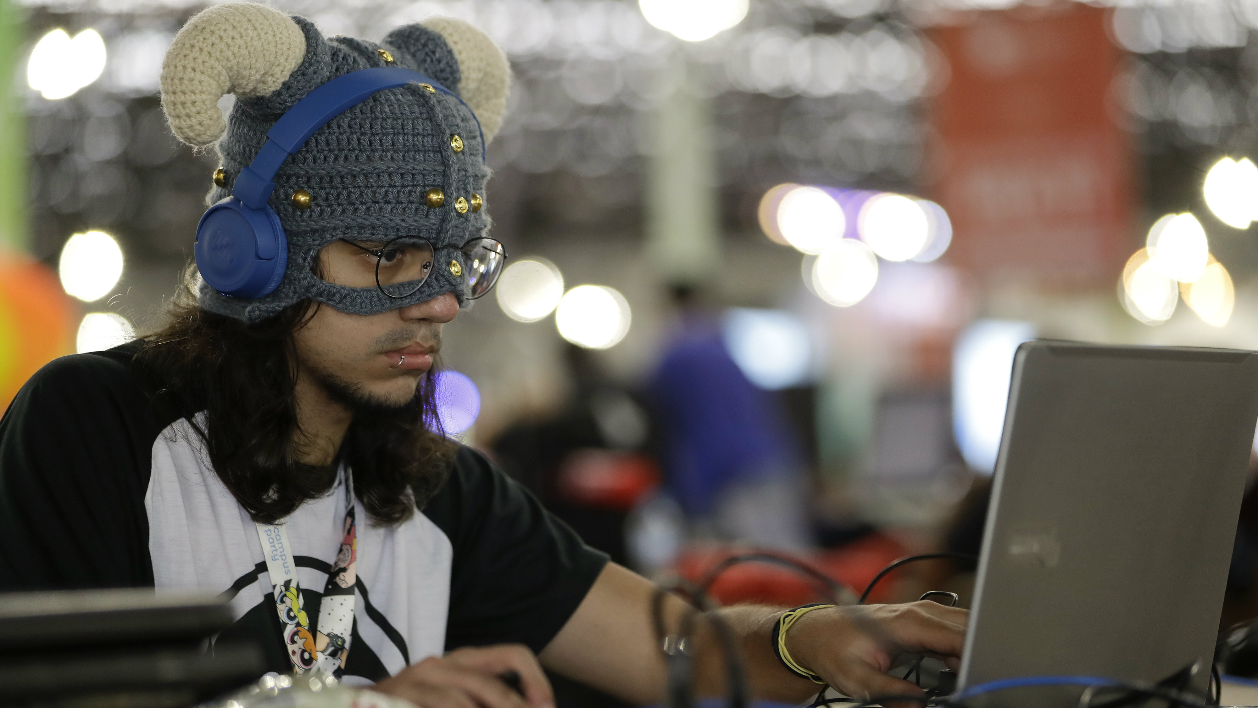 """A participant plays games at the """"Campus Party,"""" a technology festival, in Sao Paulo, Brazil, Wednesday, Jan. 31, 2018. Campus Party is an annual week-long, 24-hour technology festival that gathers hackers, developers, gamers and computer enthusiasts."""