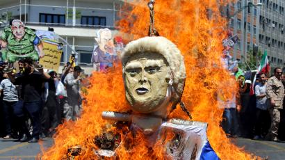 """In this Friday, June 8, 2018, photo, an effigy of the U.S. President Donald Trump is set on fire during the annual anti-Israeli Al-Quds, Jerusalem, Day rally in Tehran, Iran. For Iran, the so-called """"Axis of Evil"""" has become a lonely party of one as President Donald Trump prepares for direct talks with North Korea. With Saddam Hussein overthrown and Kim Jong Un now preparing for planned meeting in Singapore with Trump, Iran remains the last renegade among former President George W. Bush's grouping of nations opposed to the U.S. It also comes after Trump pulled out of the nuclear deal, worsening Iran's already-anemic economy."""